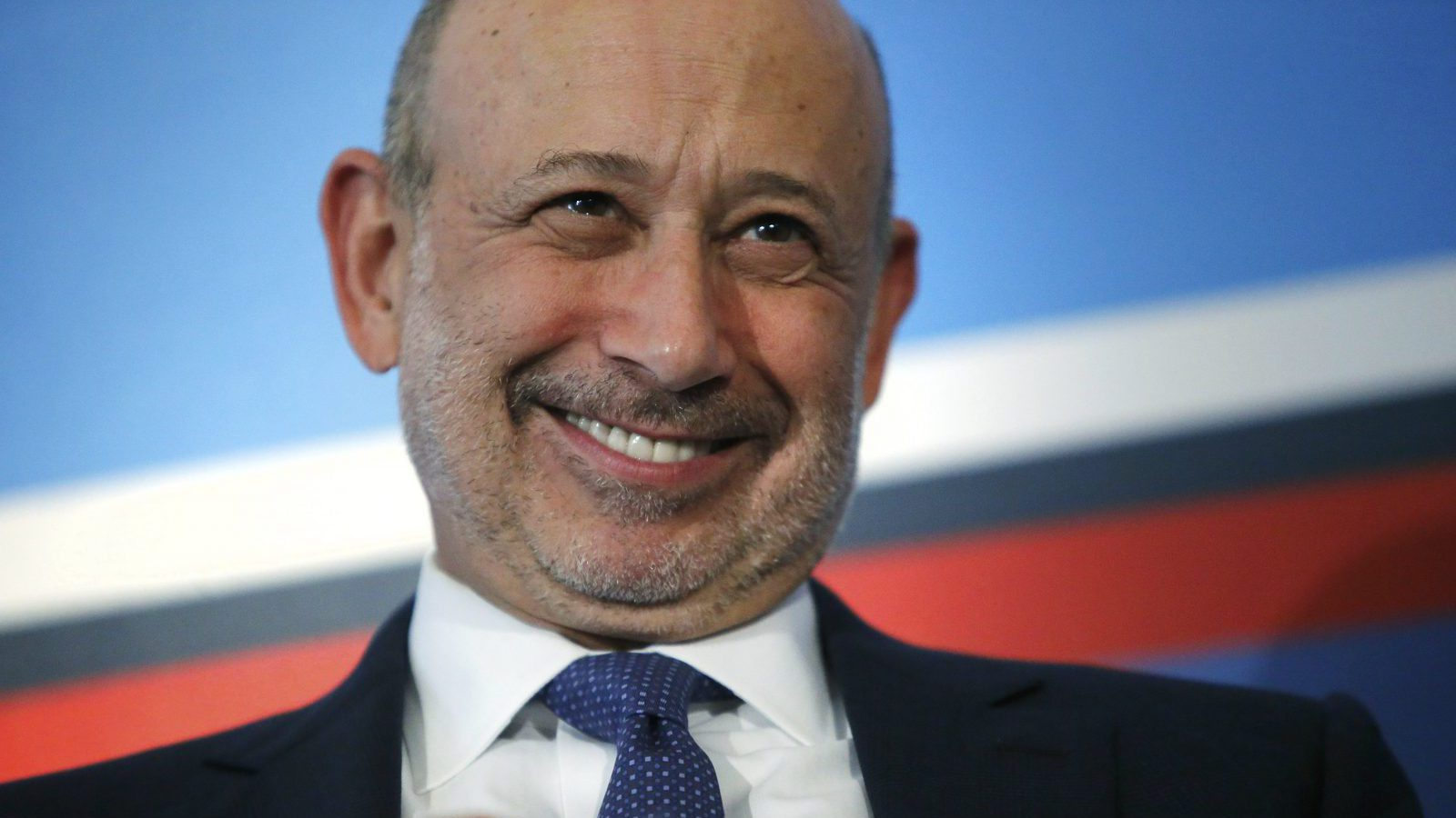 Goldman Sachs Group, Inc. Chairman and Chief Executive Officer Lloyd Blankfein smiles as he participates in a panel discussion during the White House Summit on Working Families in Washington June 23, 2014. President Barack Obama, as part of efforts to make the U.S. workplace more accommodating for employees with families, will on Monday direct federal agencies to step up efforts to give workers more leeway in determining their schedules.