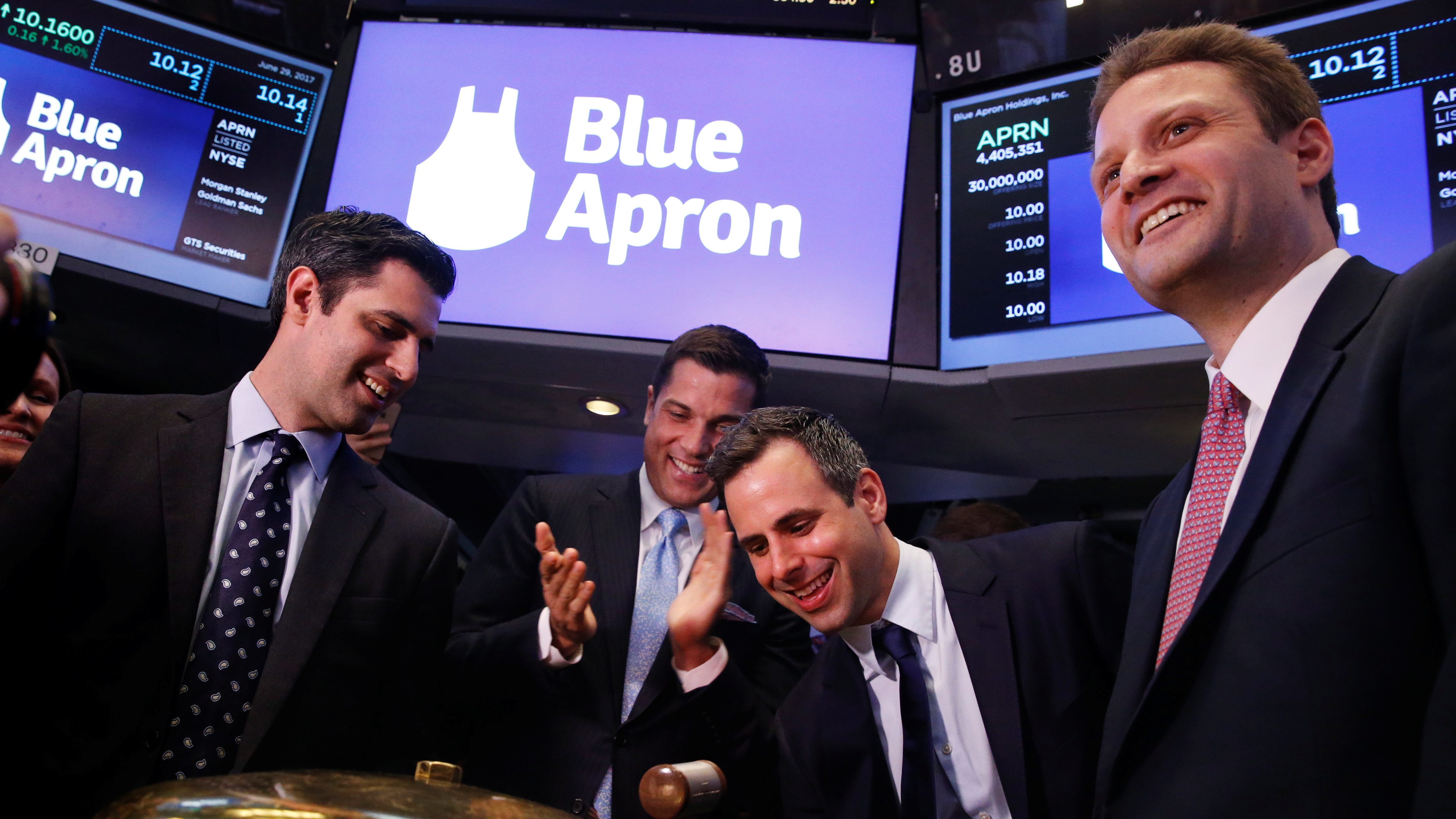 Blue Apron CEO Matthew B. Salzberg (R) watches as co-founder Matt Wadiak rings a ceremonial bell with Ilia Papas on the floor of the New York Stock Exchange for the company's IPO in New York, U.S., June 29, 2017.  REUTERS/Lucas Jackson - RTS194QL