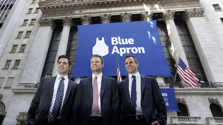 Blue Apron CEO Matt Salzberg, center, poses with fellow company co-founders Ilia Papas, left, and Matt Wadiak outside the New York Stock Exchange before the IPO begins trading, Thursday, June 29, 2017. (AP Photo/Richard Drew)