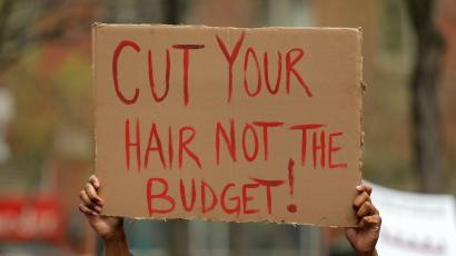 budget protest sign