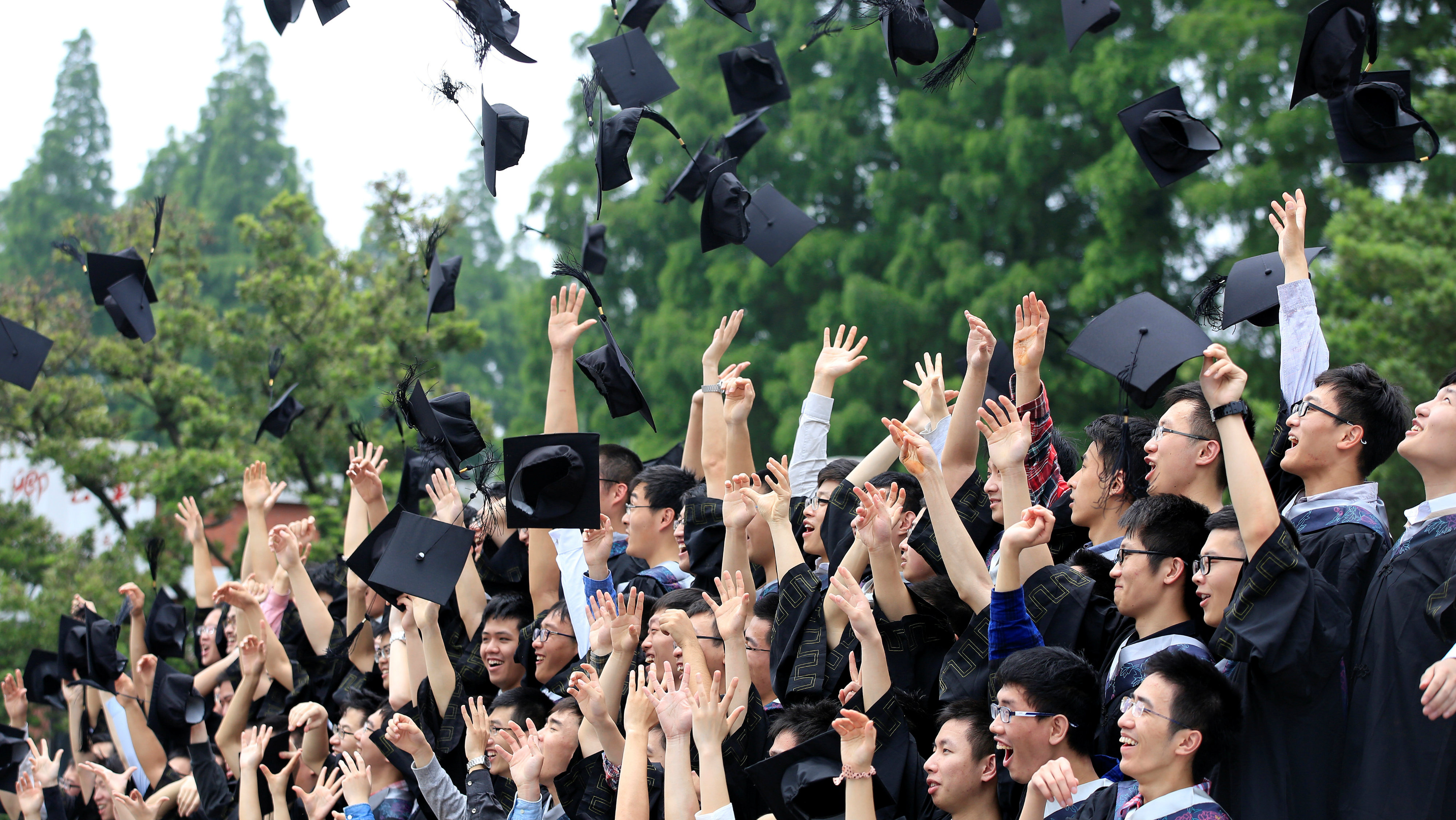 DATE IMPORTED:May 31, 2016Graduates throw their mortar boards as they pose for pictures at Fudan University in Shanghai, China May 31, 2016