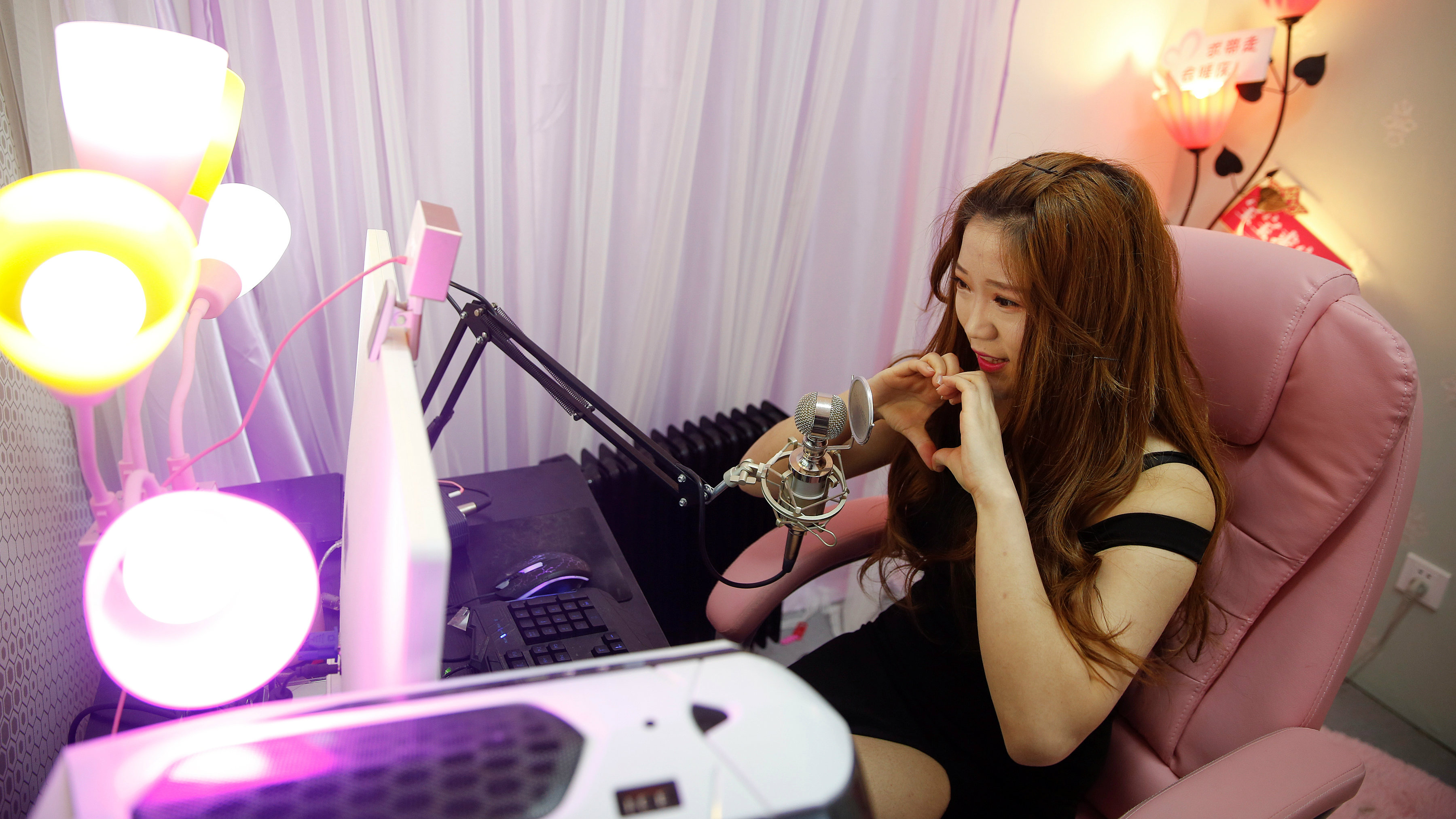 A girl broadcasts at live streaming talent agency Three Minute TV in Beijing, China, February 11, 2017.