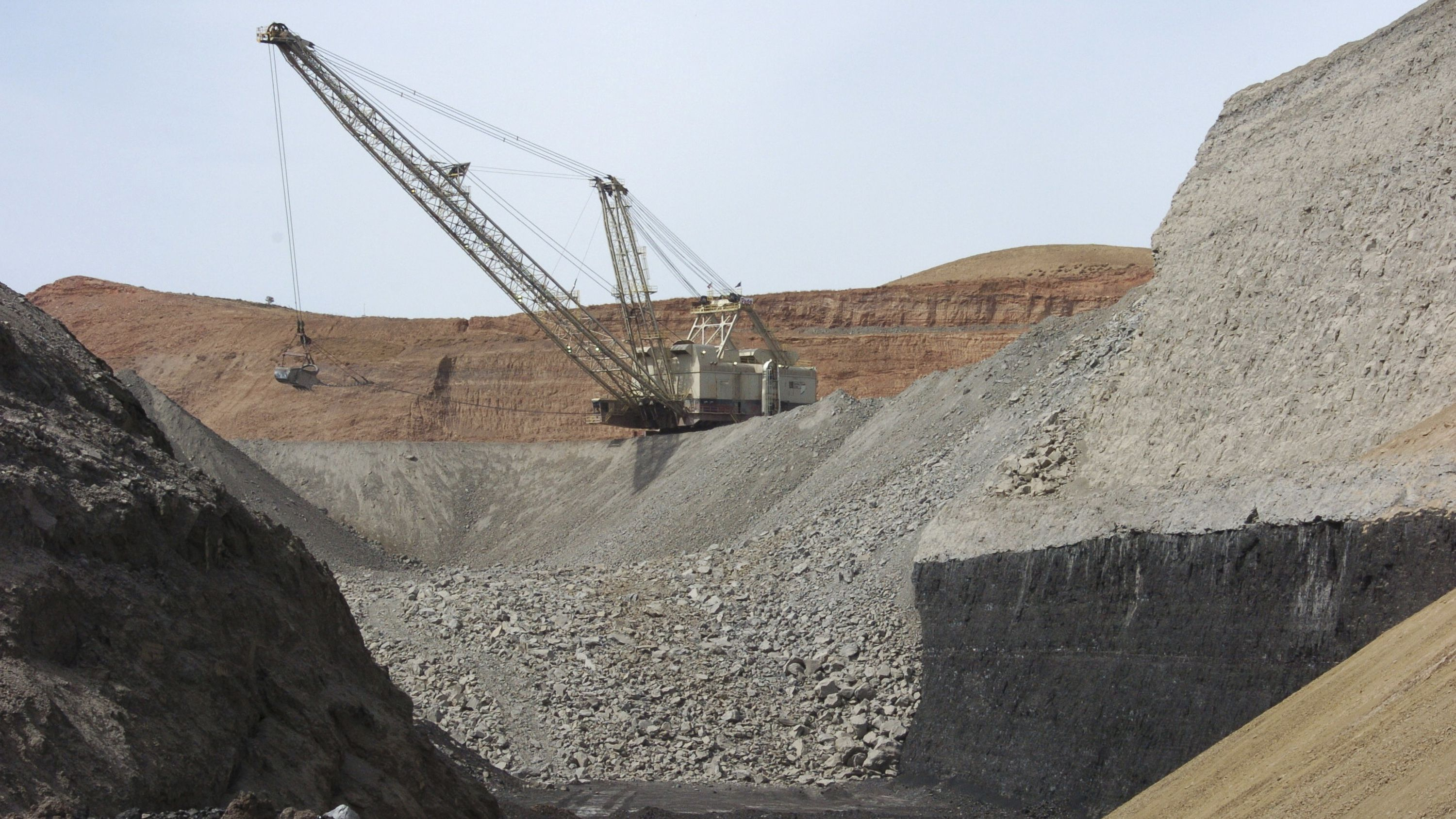 FILE--In this April 4, 2013, file photo, a dragline excavator moves rocks above a coal seam at the Spring Creek Mine in Decker, Mont. Renewable energy developers say they're hopeful about the future despite President-elect Donald Trump's promise to bring coal mining jobs back. In recent years, huge solar and wind farms have sprouted up on public desert land in the Western United States buoyed by generous federal tax credits. (AP Photo/Matthew Brown, File)
