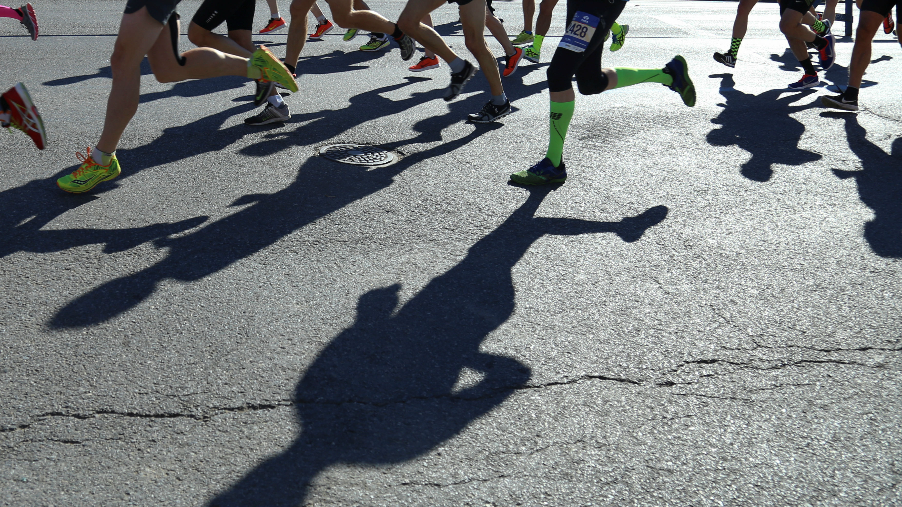 The shadows of runners hit the ground as they take part in the 2016 New York City Marathon in the Brooklyn borough of New York, U.S., November 6, 2016.