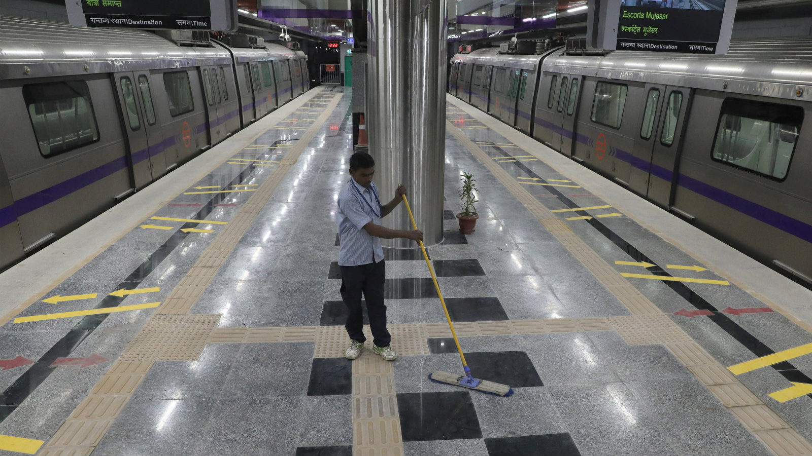 A worker at a Delhi Metro station.