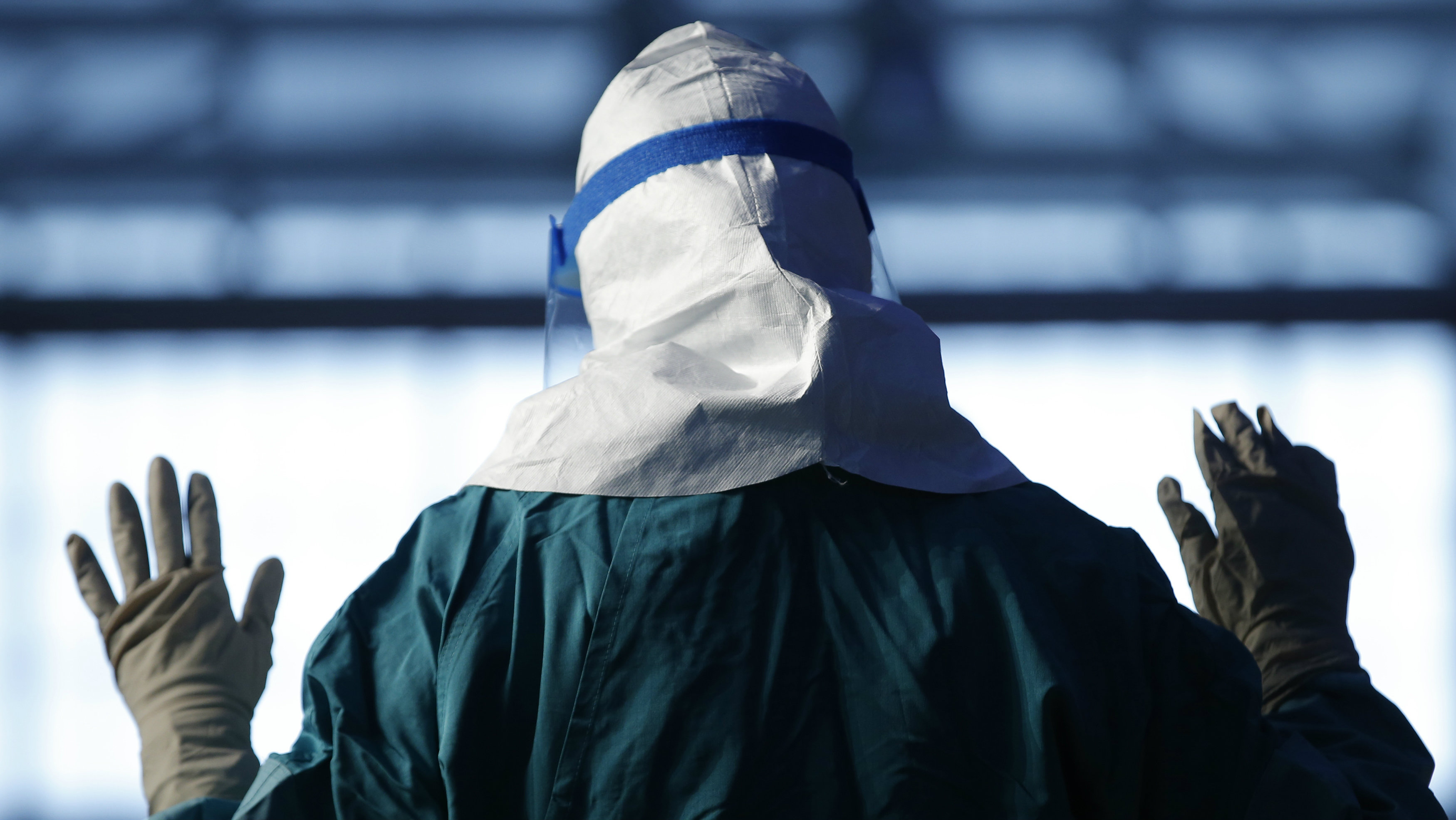 Nurse wearing protective clothing against infectious diseases