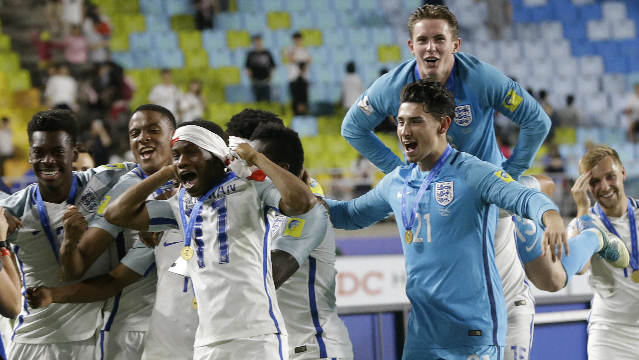 England players celebrate after defeating Venezuela 1-0 to win the final of the FIFA U-20 World Cup Korea 2017 at Suwon World Cup Stadium in Suwon, South Korea, Sunday, June 11, 2017.