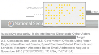 Yellow tracking dots embedded in a recently leaked NSA document, here enlarged and highlighted.