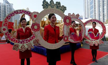 Flight attendants from Cathay Pacific Airways take part in the upcoming Chinese New Year parade during a rehearsal in Hong Kong, China January 25, 2017. REUTERS/Bobby Yip - RTSX8TN