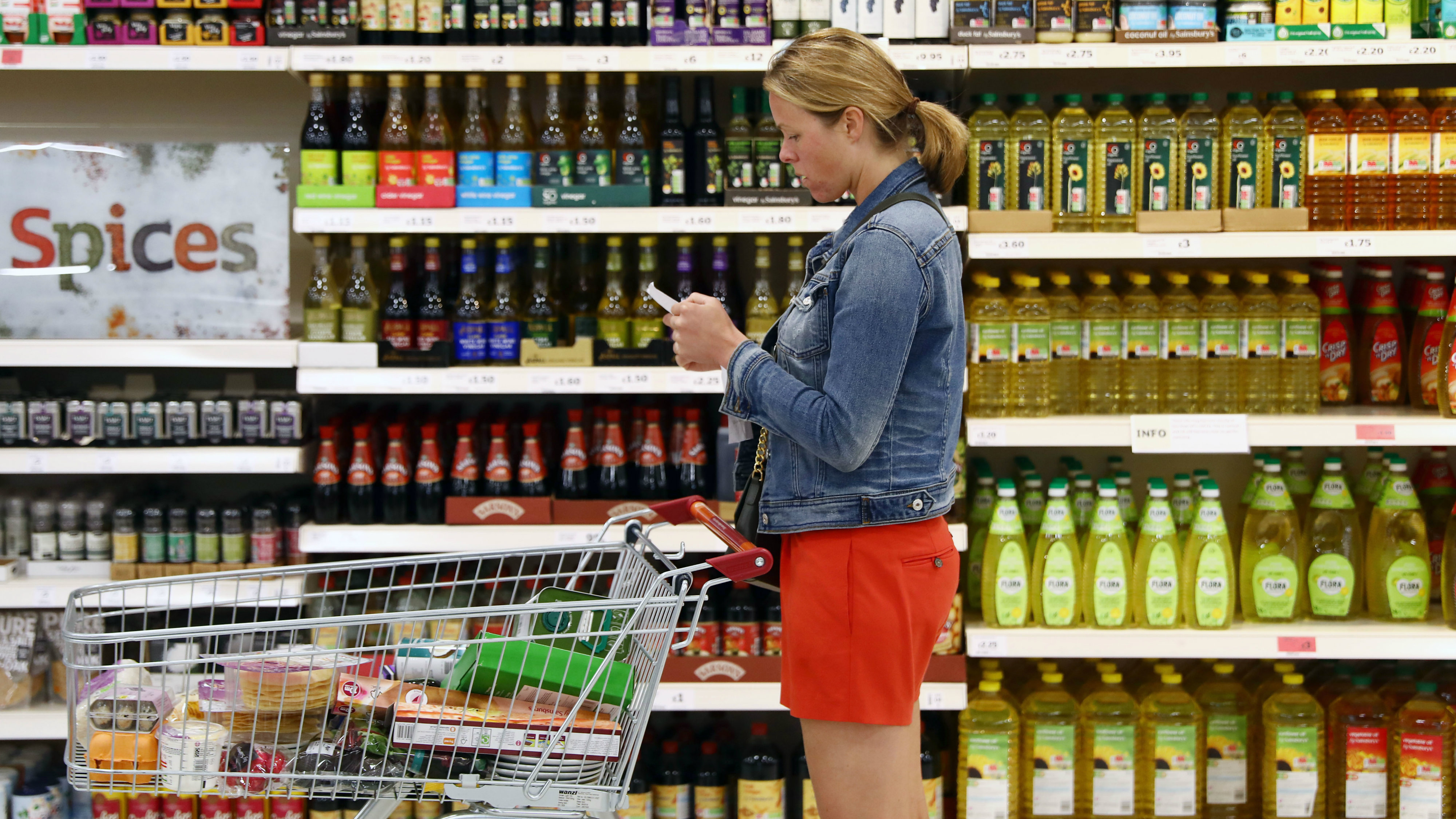Shopper buying food in a UK supermarket