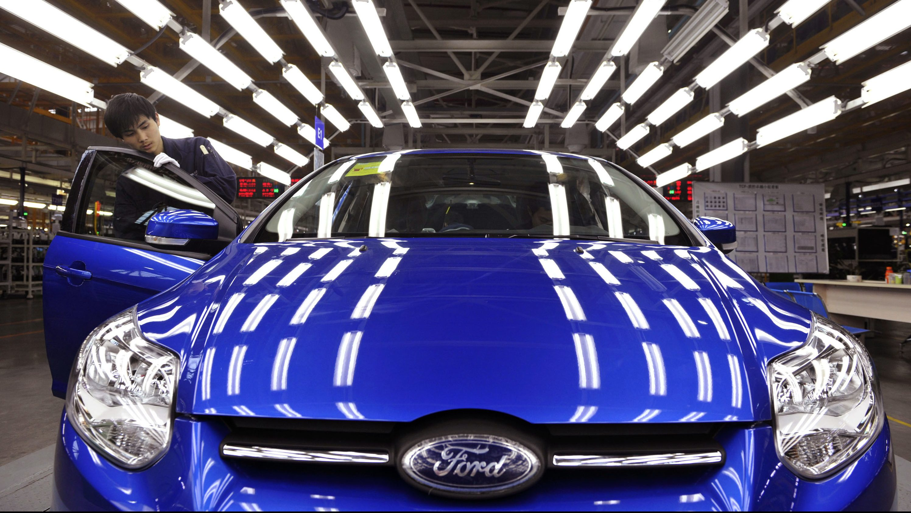 An employee works at an assembly line at a Ford manufacturing plant in China