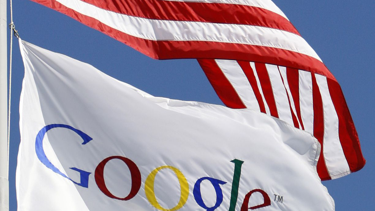 A U.S. flag flies above the Google office in Santa Monica, California, October 3, 2007. REUTERS/Lucy Nicholson (UNITED STATES)