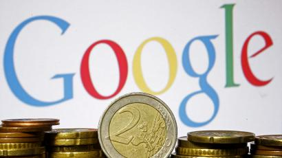 Euro coins are seen in front of a Google logo in this picture illustration