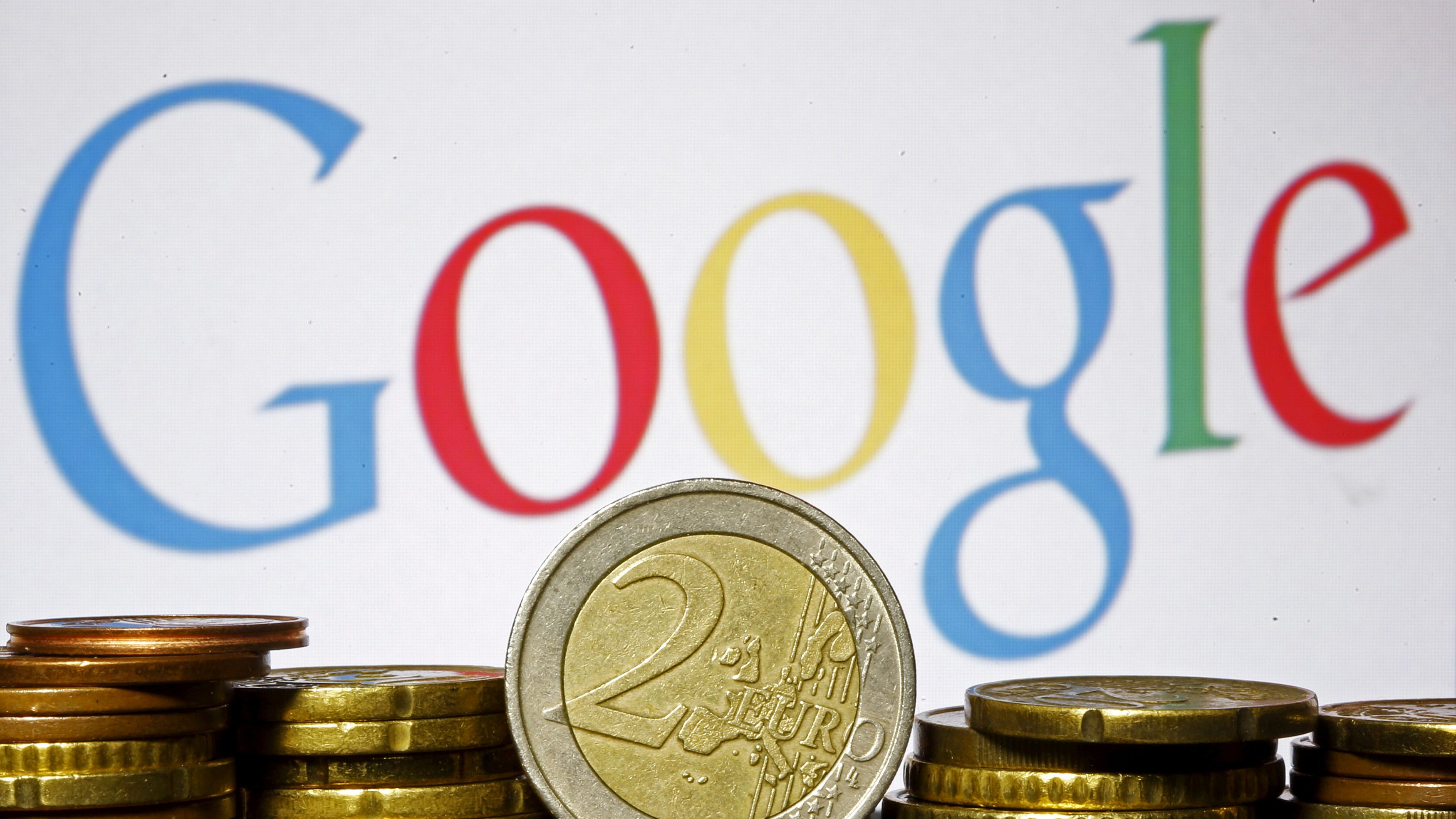 Euro coins are seen in front of a Google logo in this picture illustration, April 21, 2015.