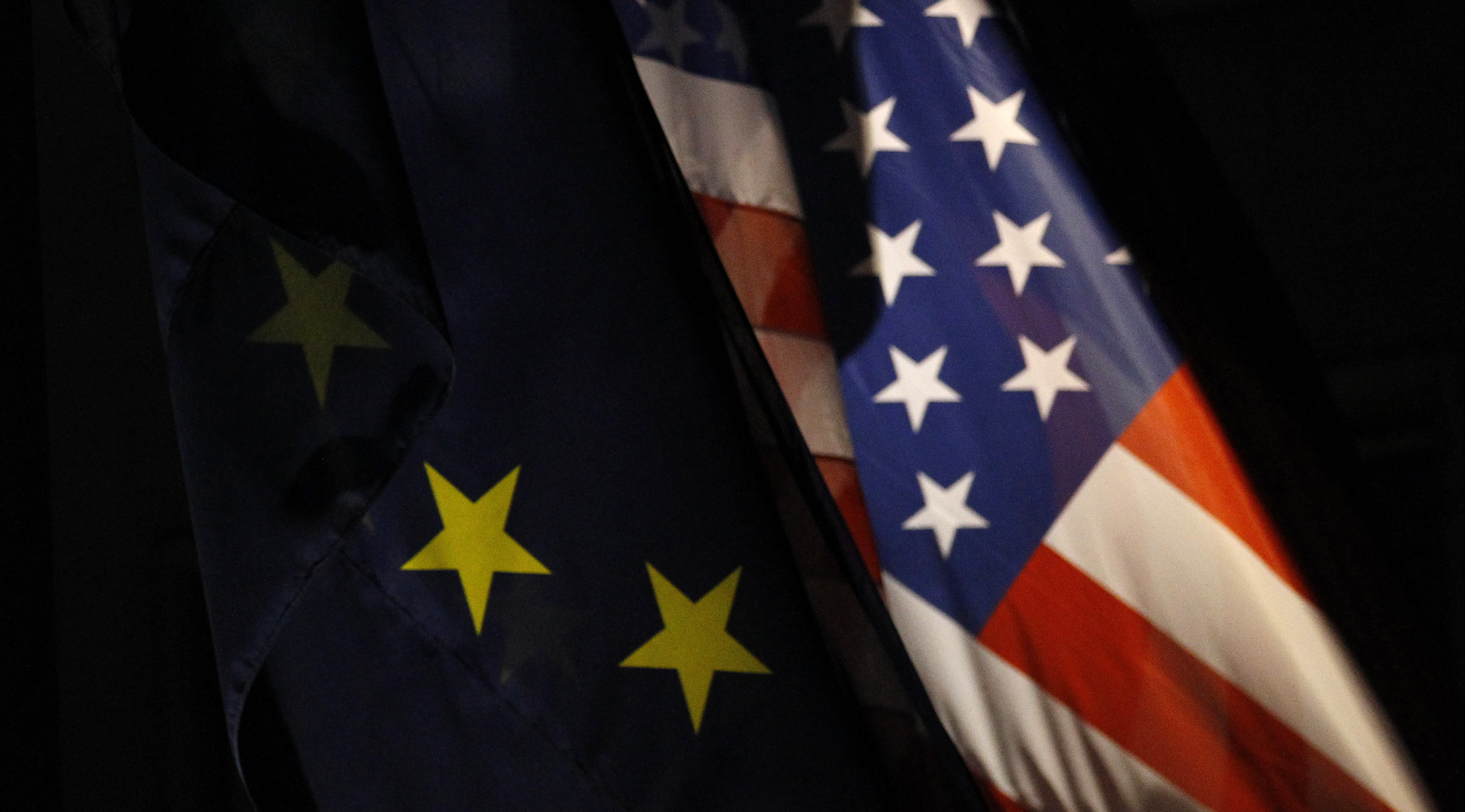 An EU flag and an U.S. flag are pictured in front of the German Finance Ministry before a meeting between German Finance Minister Wolfgang Schaeuble and U.S.Treasury Secretary Timothy Geithner in Berlin December 6, 2011.