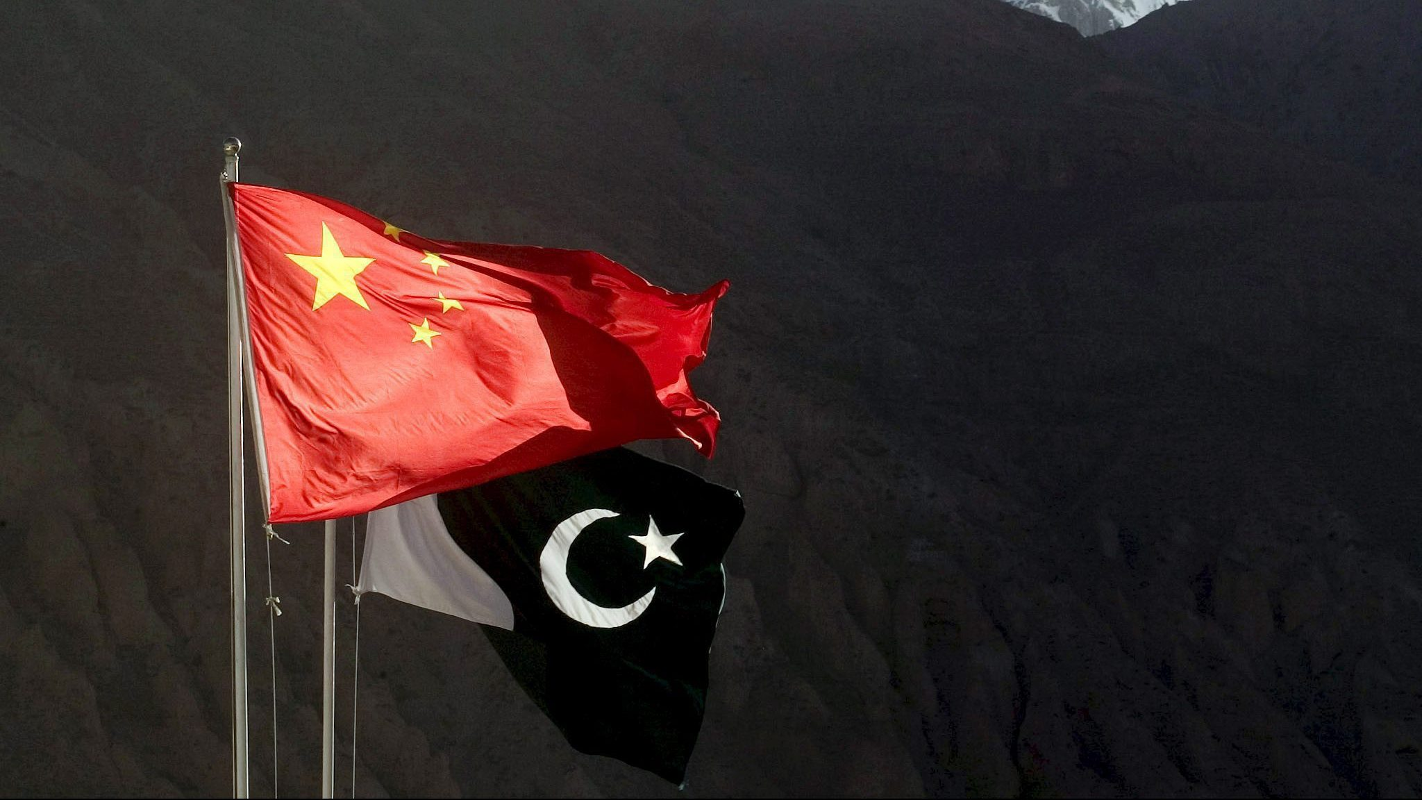 Pakistani (R) and Chinese flags wave at 4,730 meters (15,520 ft) high Khunjerab Pass, a high pass on the northern border of Pakistan with China, Saturday, 11 June 2005. This section of the road was completed in 1982 and is considered to be the highest metal border crossing in the world. The pass is often snow covered and during the rainy season (December-April), because of mudslides the pass is closed to all vehicles except large trucks.  Pakistan and China?s formal relations were founded on 1951. Since then, relations between the two countries in almost all domains of life have not suffered any setback. Pakistan?s imports from China have been increasing since early 1980s and this is certainly beneficial for the country, as Pakistan has to pay less for imports from China as compared to the imports from the developed countries for the same type of commodities/machinery.