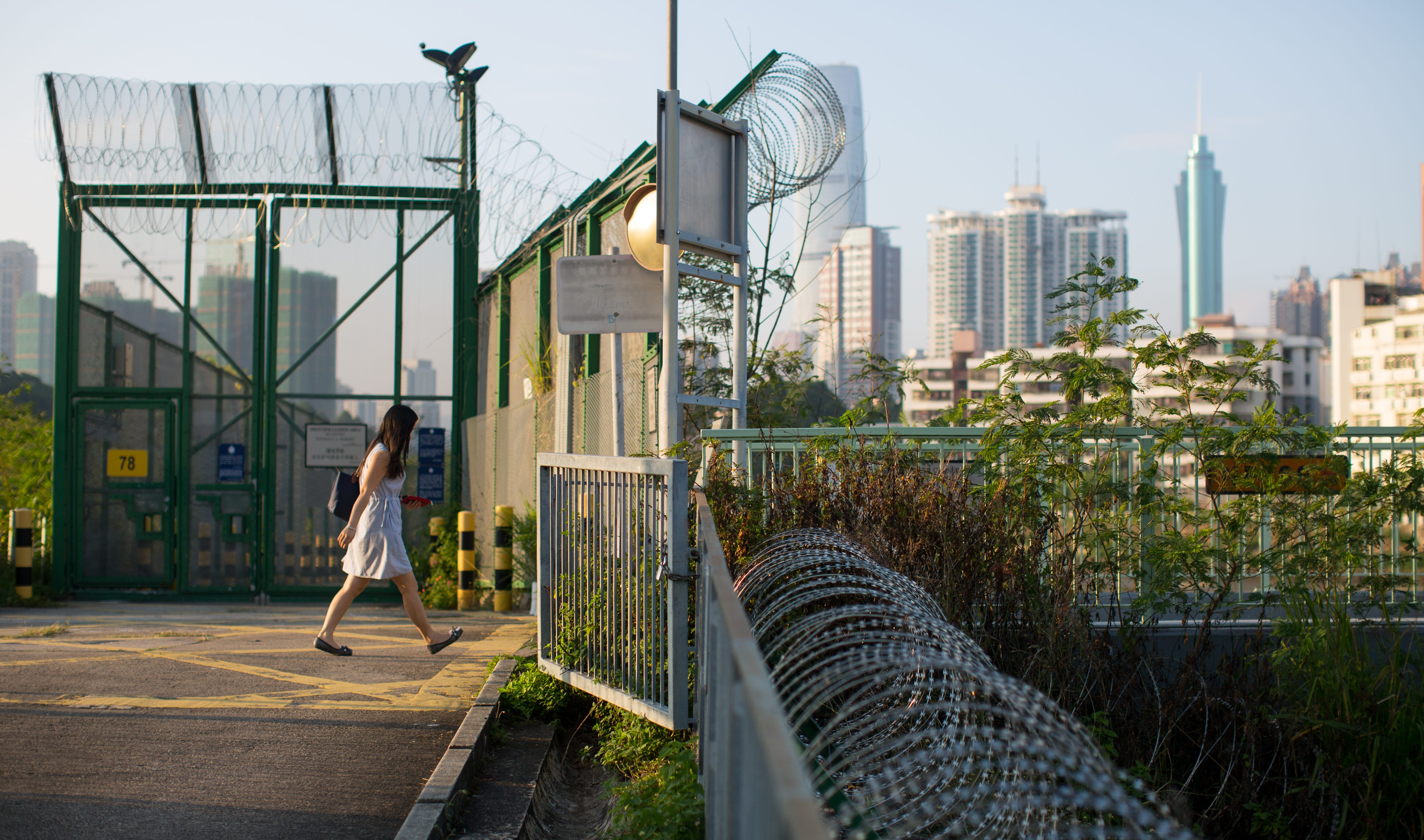 A villager crosses a bridge into a Frontier Closed Area to access Lo Wu subway station in Hong Kong, 12 November 2016.
