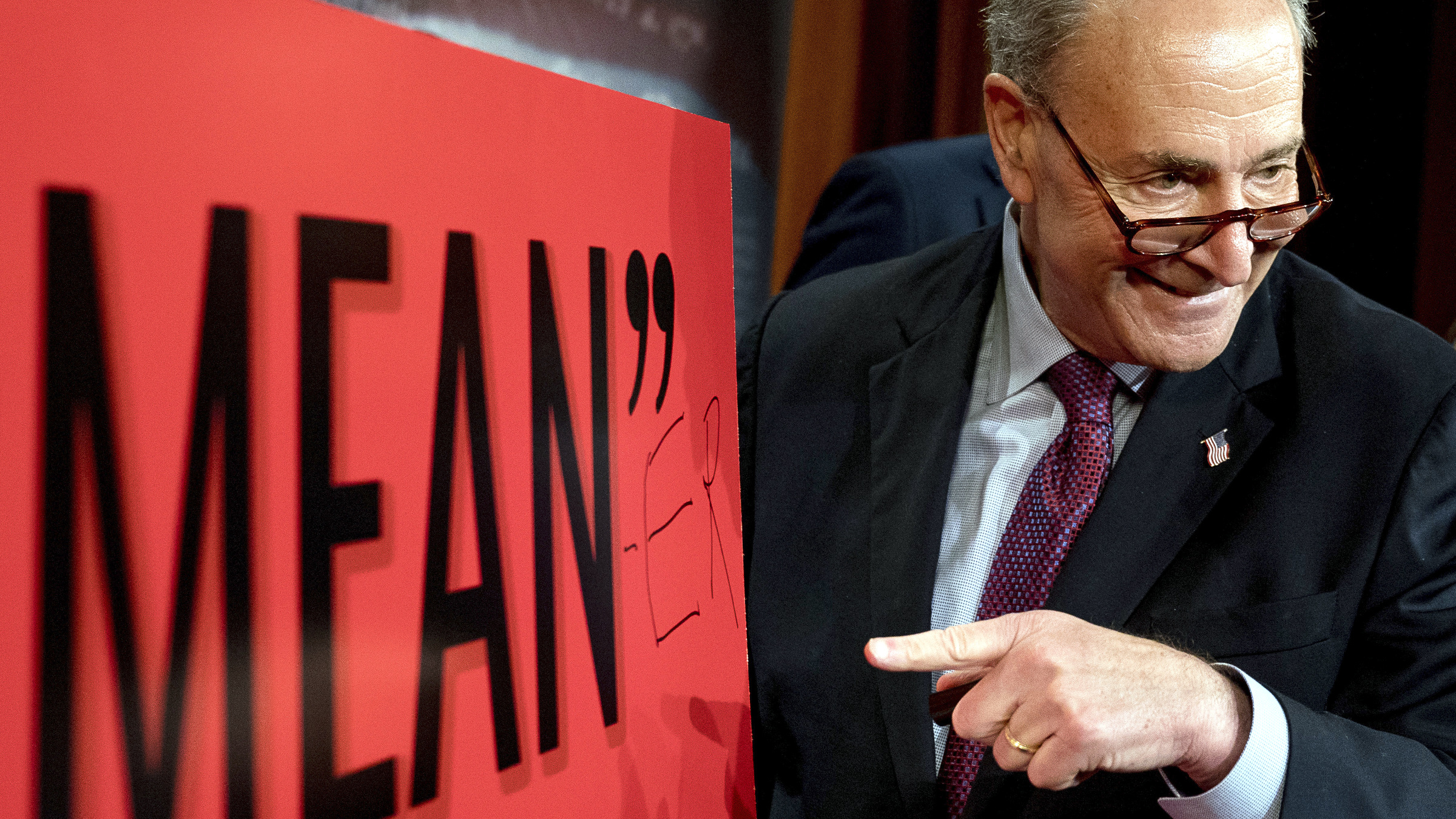 """Senate Minority Leader Chuck Schumer, D-N.Y., writes """"Mean-er"""" on a reported quote by President Donald Trump as Schumer responds to the release of the Republicans' healthcare bill which represents the long-awaited attempt to scuttle much of President Barack Obama's Affordable Care Act, at the Capitol in Washington, Thursday, June 22, 2017."""