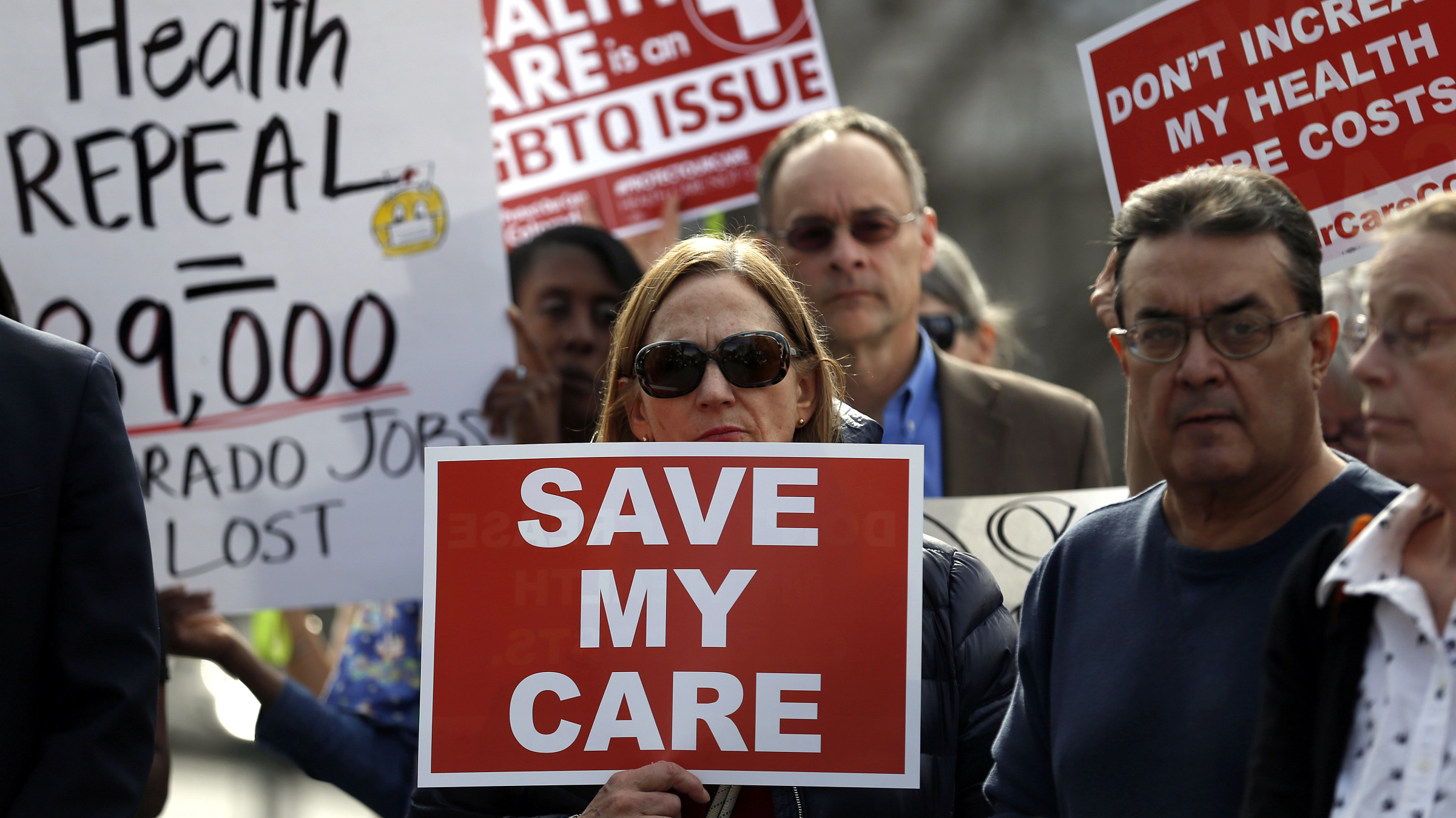 Supporters of the Affordable Care Act who are also opponents of Colorado's GOP-led plan to undo Colorado's state-run insurance exchange gather for a rally organized by the national Save My Care Bus Tour, on the state Capitol steps in Denver, Tuesday, Feb. 7, 2017. A bill being heard in the Senate Finance Committee Tuesday, Feb. 7, 2017 would abolish the state-run health insurance exchange. (