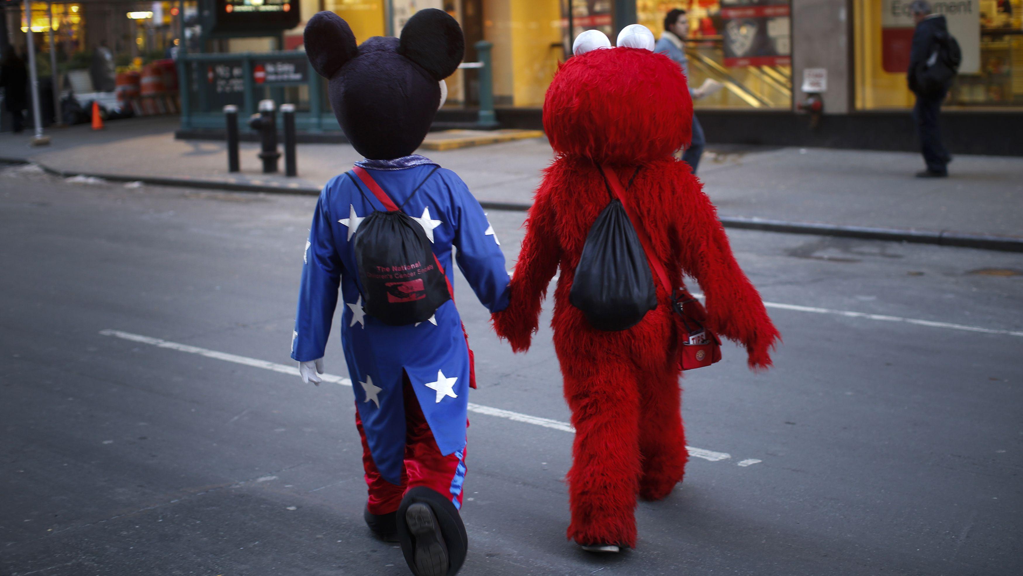 holding hands mascots