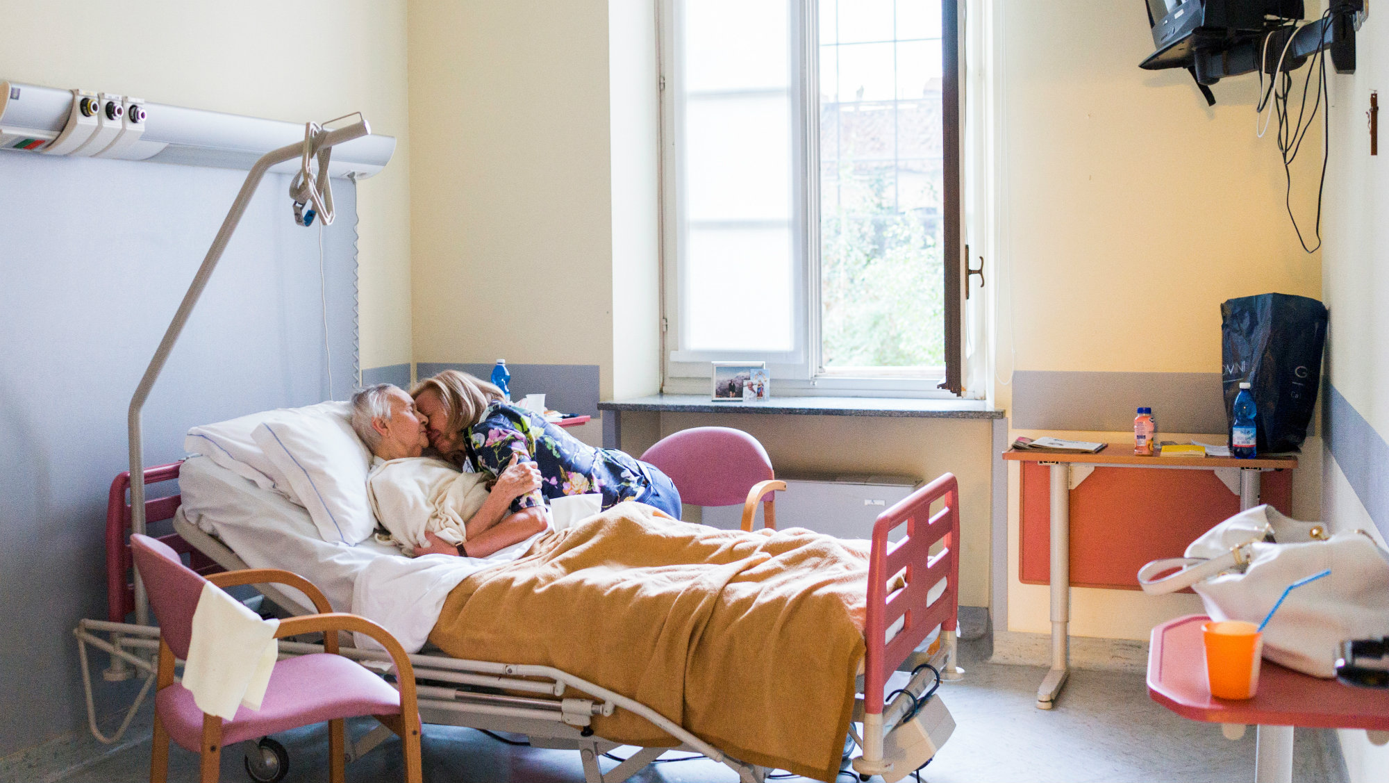 Chiara Micheletti embraces her mother Marisa Vesco in her room at a hospice where she stayed for a month and a half before her death in Biella, Italy, August 21, 2015.