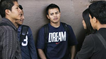 immigrant youth wait in line for assistance with paperwork for DACA