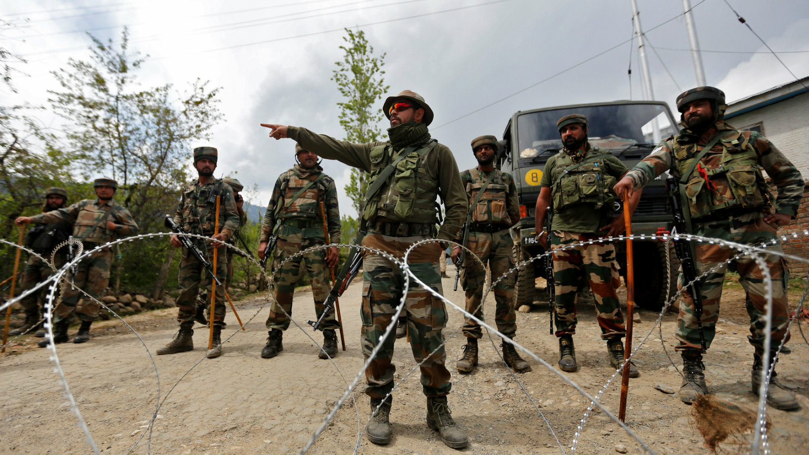 Indian army soldiers stand guard inside their army base after it was attacked by suspected separatist militants in Panzgam in Kashmir's Kupwara district, April 27, 2017.
