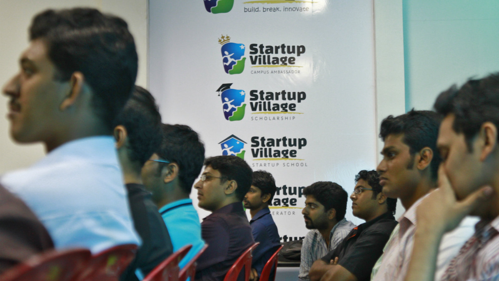 Entrepreneurs, employees and students listen to a speech during the Start-up saturday event at the Start-up Village in Kinfra High Tech Park in the southern Indian city of Kochi October 13, 2012. Three decades after Infosys, India's second-largest software service provider, was founded by middle-class engineers, the country has failed to create an enabling environment for first-generation entrepreneurs. Startup Village wants to break the logjam by helping engineers develop 1,000 Internet and mobile companies in the next 10 years. It provides its members with office space, guidance and a chance to hobnob with the stars of the tech industry. But critics say this may not even be the beginning of a game-changer unless India deals with a host of other impediments - from red tape to a lack of innovation and a dearth of investors - that are blocking entrepreneurship in Asia's third-largest economy. To match Feature INDIA-TECHVILLAGE/ Picture taken October 13, 2012.