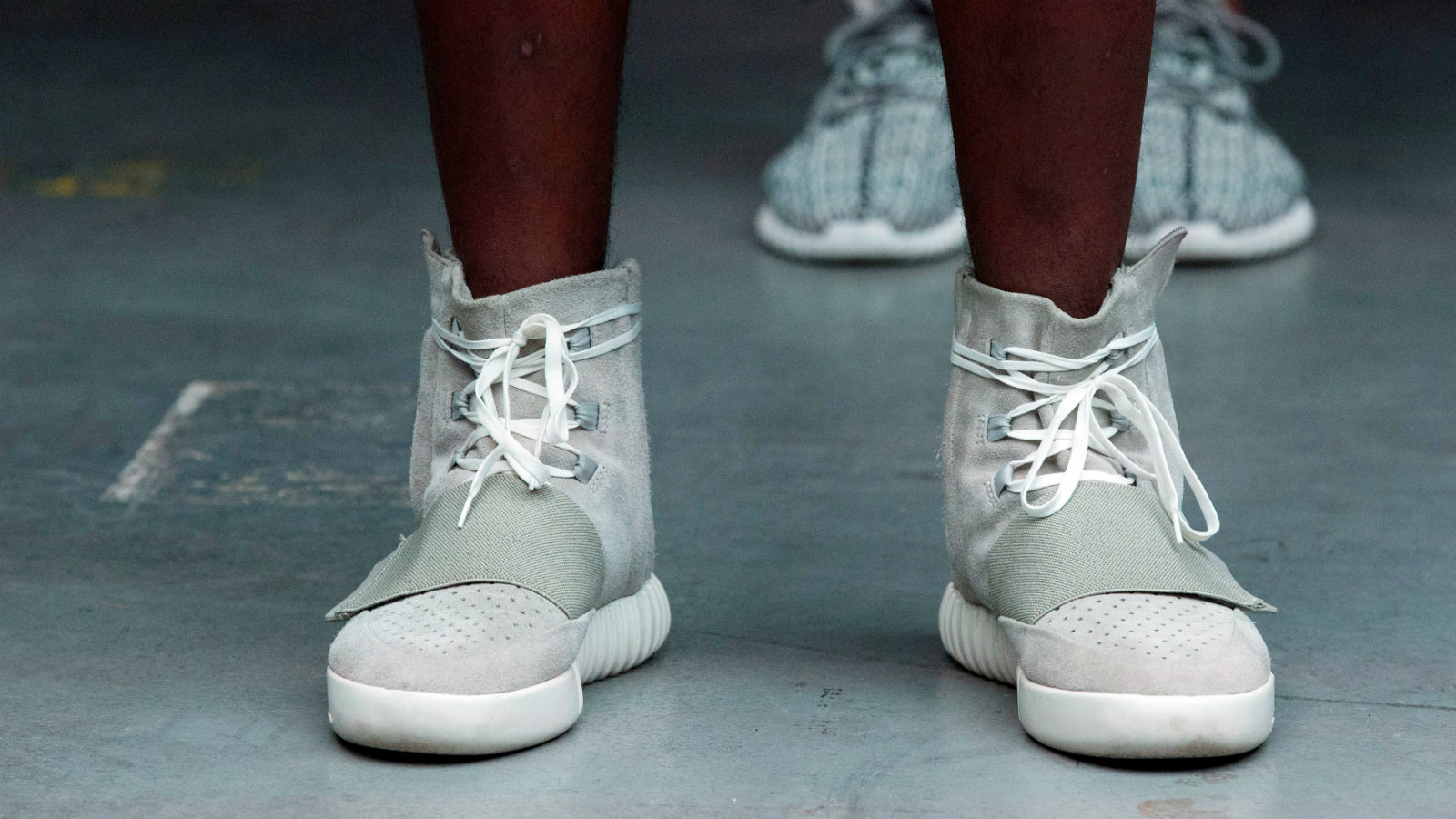 A model wears a pair of Adidas Yeezy 750 Boost shoes designed by Kanye West as part of his Fall/Winter 2015 partnership line with Adidas at New York Fashion Week, U.S. February 12, 2015. Picture taken February 12, 2015.