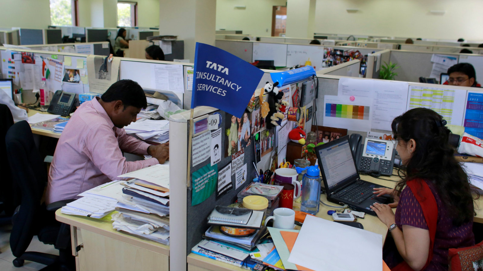 Employees of Tata Consultancy Services (TCS) work inside the company headquarters in Mumbai March 14, 2013.