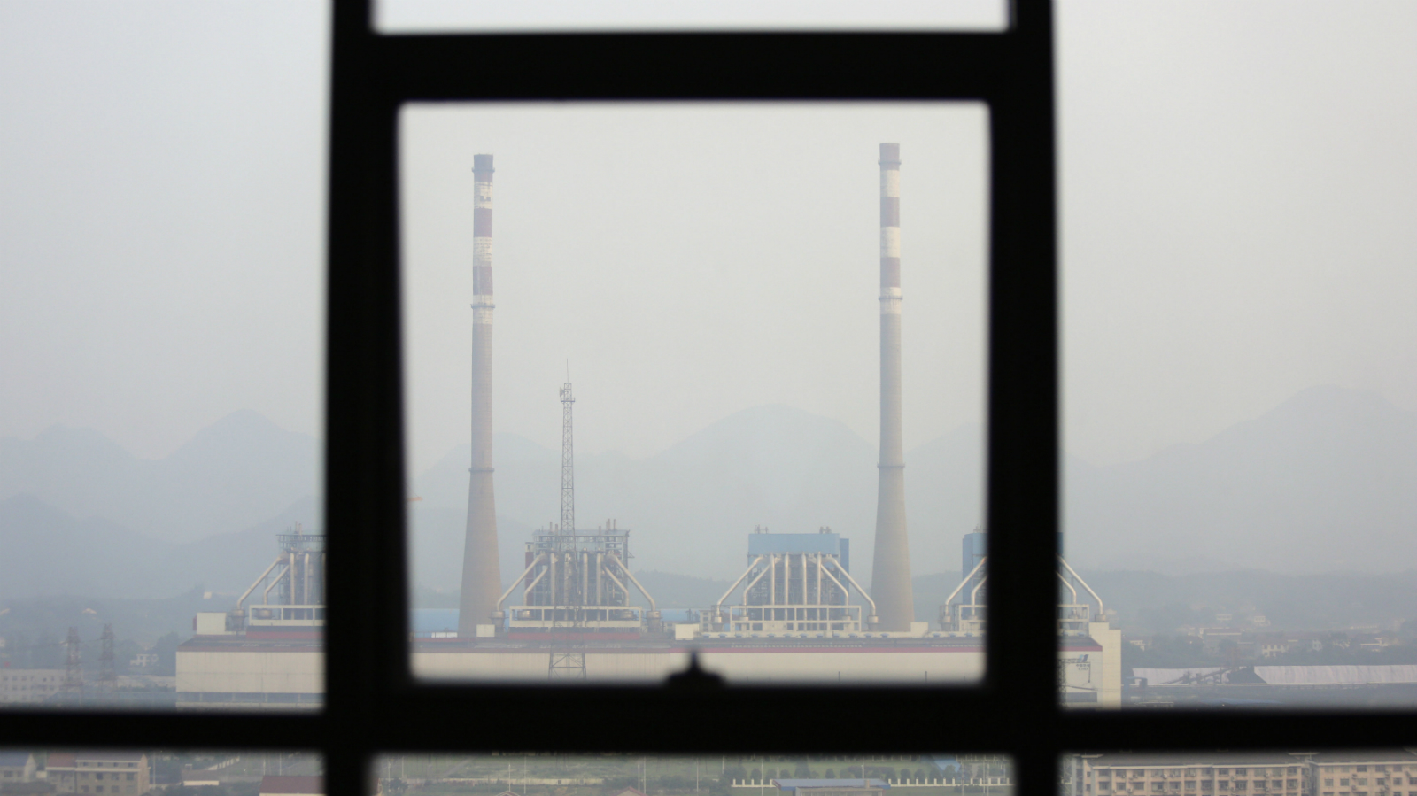 Chimneys are seen through a window at a coal-fired power plant on a hazy day in Shimen county, central China's Hunan Province, June 2, 2014. U.S. President Barack Obama's plan to cut greenhouse gas emissions from U.S. power plants, due to be announced on Monday, will win muted applause abroad with some hopes it could help a U.N. deal to fight climate change in 2015. Emerging economies including China and India are likely to be lukewarm because they have often said that Obama's plans for emissions cuts until 2020 - even if fully implemented - are far short of the curbs they say are needed by the rich. (CHINA - Tags: ENVIRONMENT BUSINESS ENERGY CITYSCAPE)