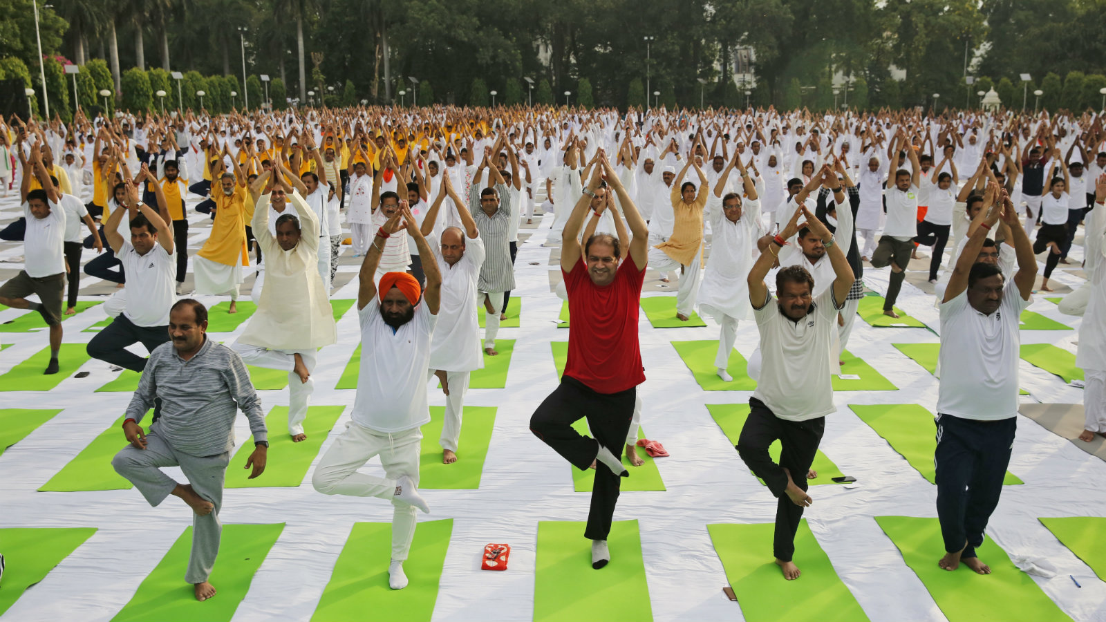 Indians perform Yoga in Lucknow, India, Wednesday, June 7, 2017. The yoga training camp was organized for the upcoming International Yoga Day, which is celebrated annually on June 21.