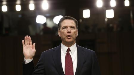 Former FBI Director James Comey is sworn in prior to testifying before a Senate Intelligence Committee hearing on Russia's alleged interference in the 2016 U.S. presidential election on Capitol Hill in Washington, U.S.