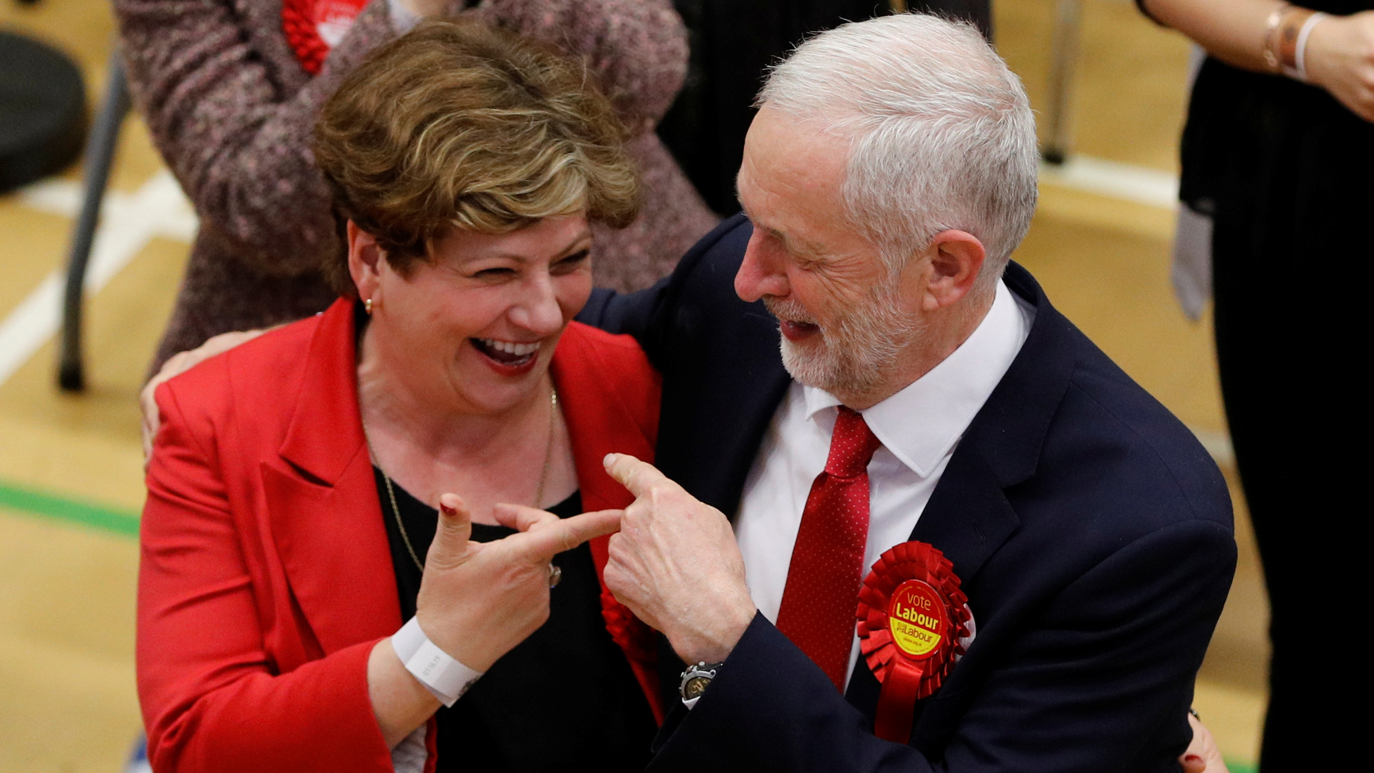 Jeremy Corbyn, leader of Britain's opposition Labour Party, and Labour Party candidate Emily Thornberry gesture at a counting centre for Britain's general election in London, June 9, 2017. REUTERS/Darren Staples - RTX39QOZ