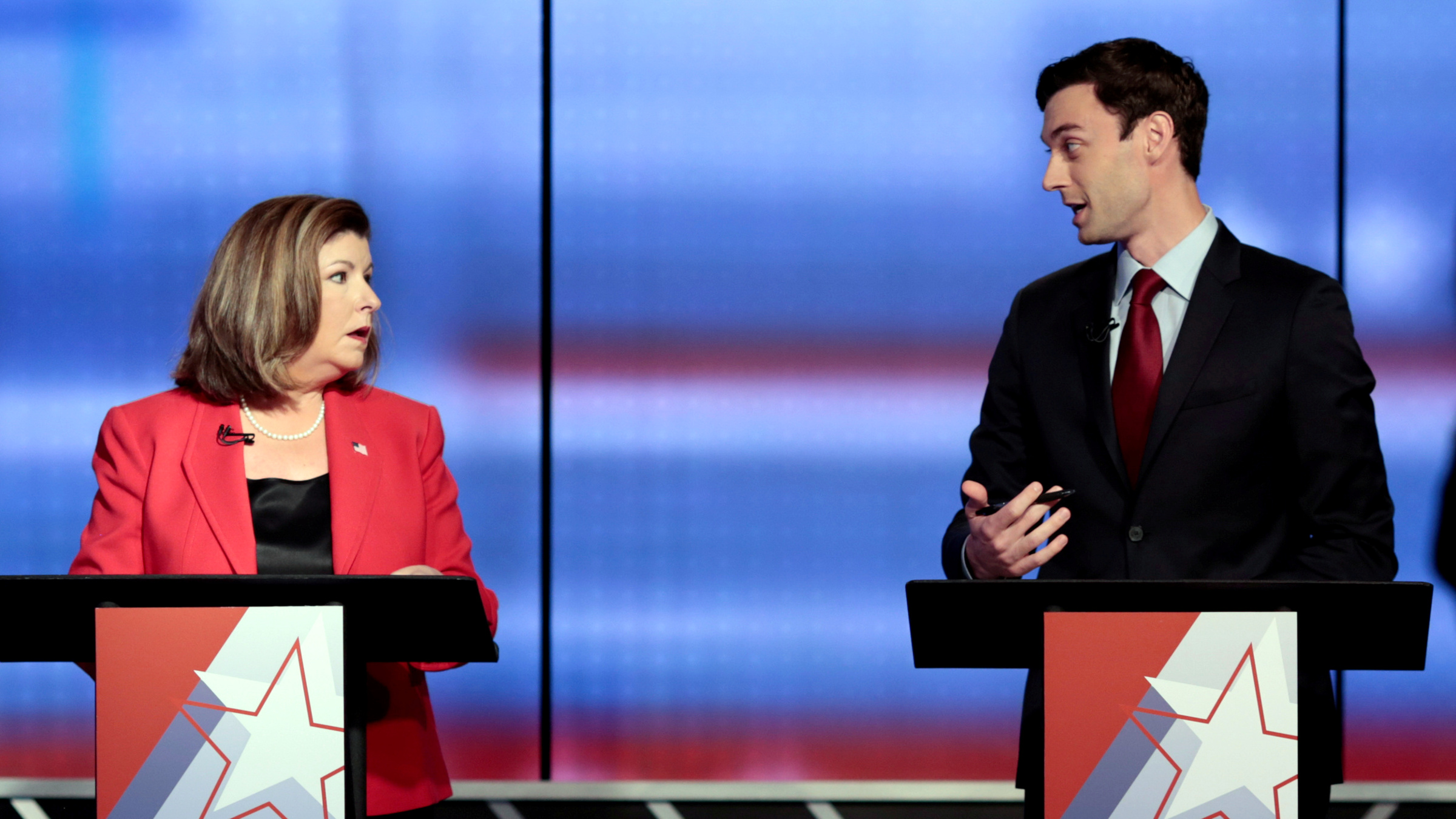 FILE PHOTO - Republican candidate Karen Handel and Democratic candidate Jon Ossoff exchange words moments before Georgia's 6th Congressional District special election debate at WSB-TV studios in Atlanta, Georgia, U.S. on June 6, 2017.
