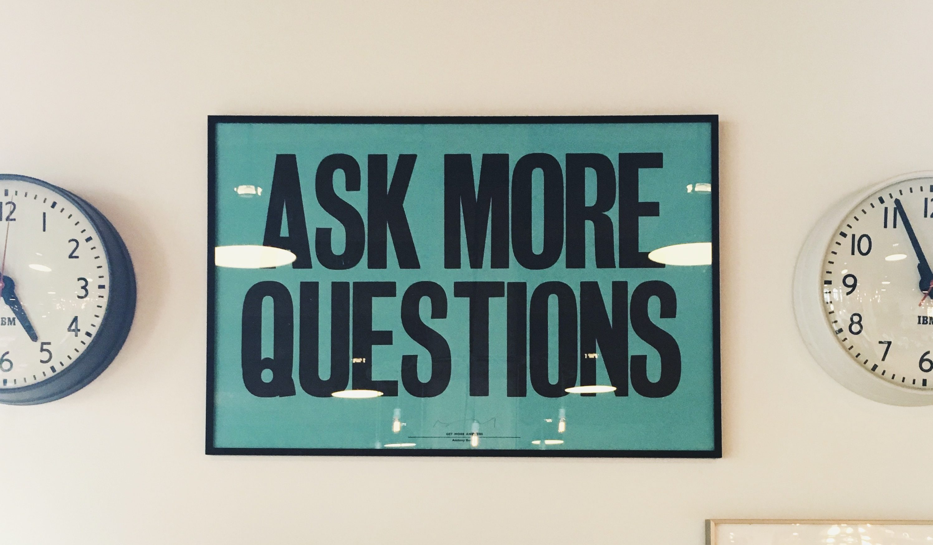 """Sign reading """"ASK MORE QUESTIONS"""""""