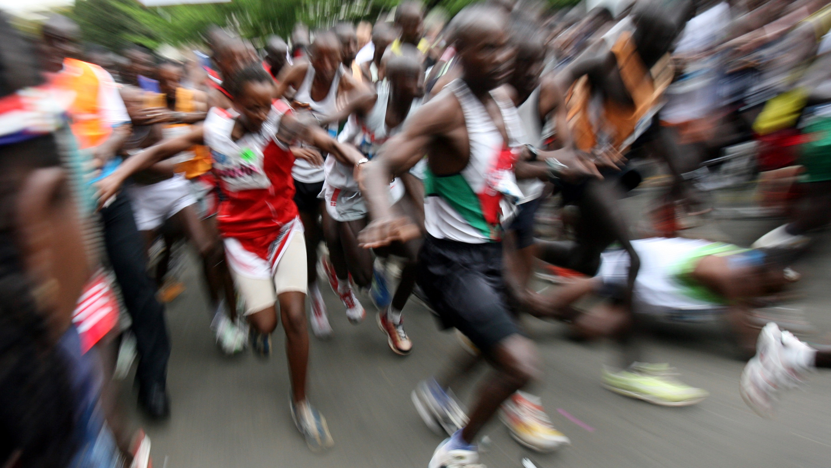 "Participants push each other at the start of Nairobi marathon October 23, 2005. Kenya's Samson Barmau won the first leg of the four-race series known as the ""Greatest Race on Earth"" in two hours 12 minutes and 35 seconds while his compatriot Caroline Cheptanui won the womens' run in two hours 36 minutes and 10 seconds. The other marathons in the series will take place in Singapore, Mumbai and Hong Kong. REUTERS/Radu Sigheti - RTR18N1G"