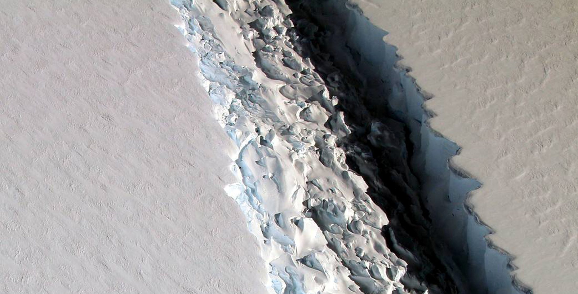 Handout photo of an oblique view of a massive rift in the Antarctic Peninsula's Larsen C ice shelf is shown in Antarctica
