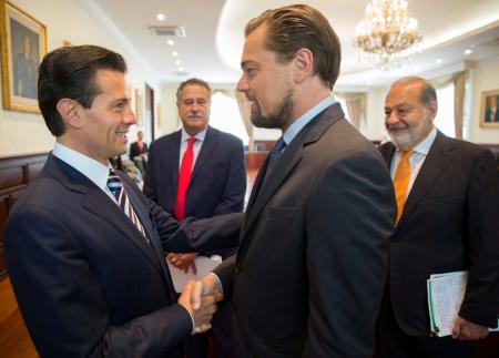 Mexico's President Enrique Pena Nieto shakes hands with actor Leonardo DiCaprio as tycoon Carlos Slim looks on