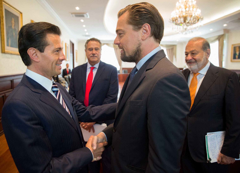 Mexico's President Enrique Pena Nieto shakes hands with actor Leonardo DiCaprio as tycoon Carlos Slim looks on