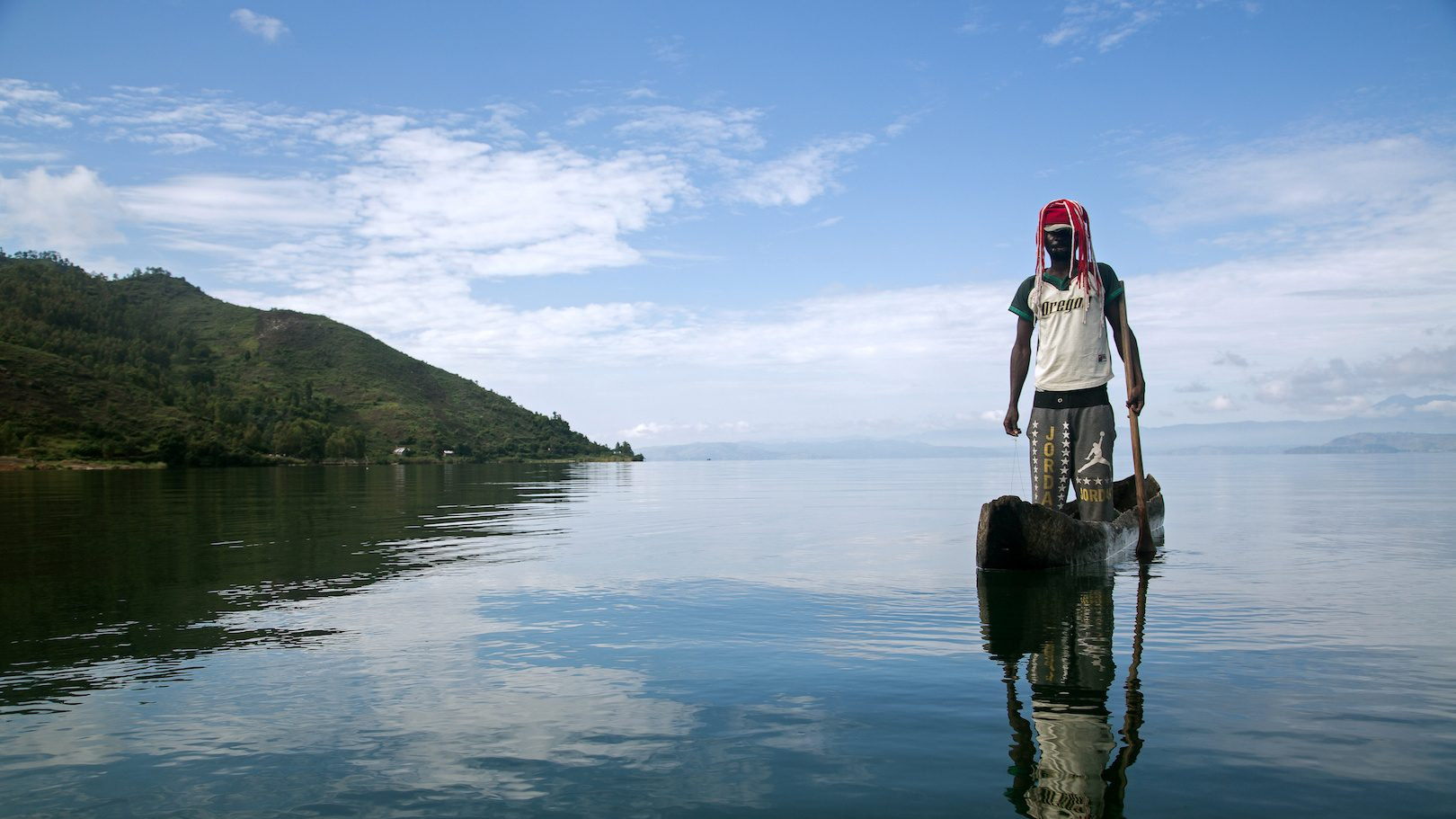 Manguiste, 24, stands in a canoe on Lake Kivu just off Idjwi island in the Democratic Republic of Congo,  November 26, 2016.