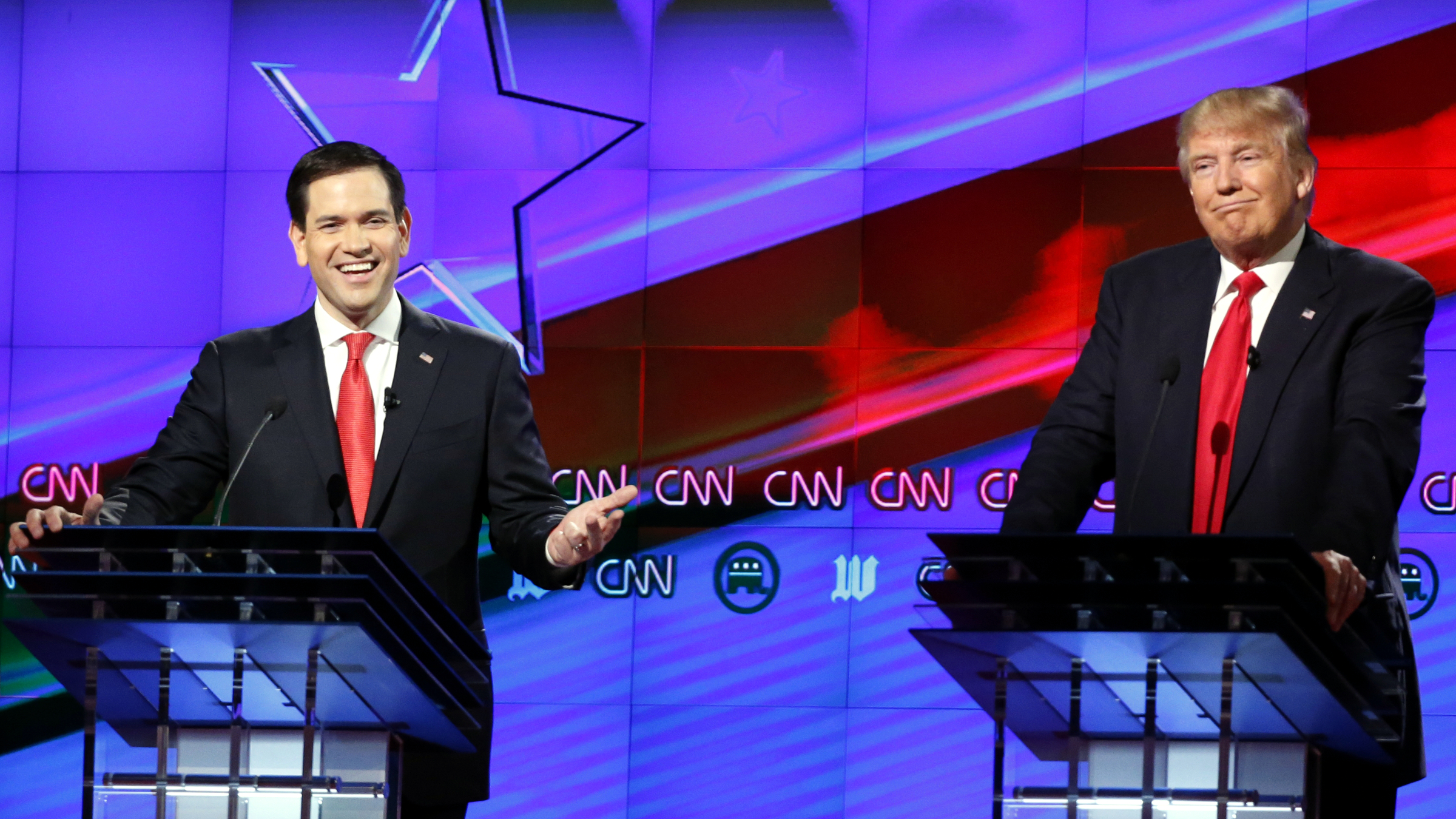 Republican presidential candidate, Sen. Marco Rubio, R-Fla., smiles, as Republican presidential candidate, businessman Donald Trump, grimaces, during the Republican presidential debate sponsored by CNN, Salem Media Group and the Washington Times at the University of Miami, Thursday, March 10, 2016, in Coral Gables, Fla.