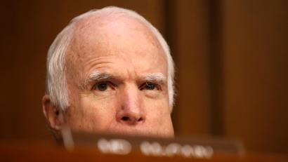 Sen. John McCain (R-AZ), who is not on the committee, watches as former FBI Director James Comey testifies before a Senate Intelligence Committee hearing on Russia's alleged interference in the 2016 U.S. presidential election on Capitol Hill in Washington, U.S., June 8, 2017. REUTERS/Jonathan Ernst - RTX39OMY