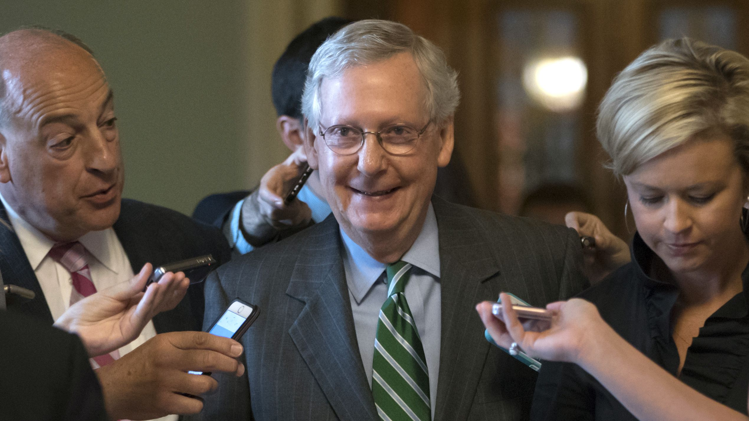 Senate Majority leader Mitch McConnell smiles as he leaves the chamber after announcing the release of the Republicans' healthcare bill which represents the party's long-awaited attempt to scuttle much of President Barack Obama's Affordable Care Act, at the Capitol in Washington, Thursday, June 22, 2017. The measure represents the Senate GOP's effort to achieve a top tier priority for President Donald Trump and virtually all Republican members of Congress.