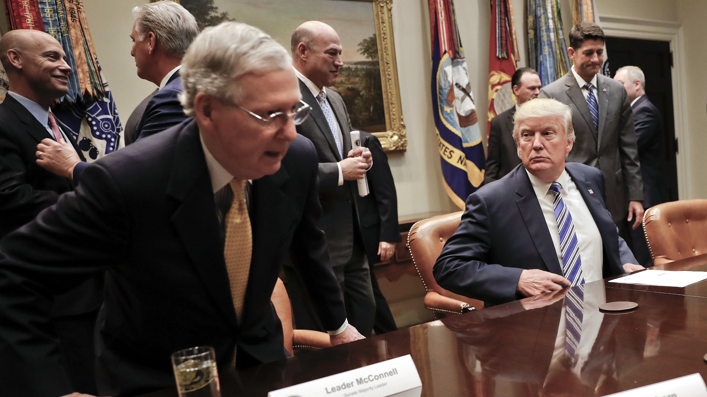 President Donald Trump, center, waits for Senate Majority Leader Mitch McConnell of Ky., left, and House Speaker Paul Ryan of Wis., right, to take their seats to begin a meeting with House and Senate Leadership in the Roosevelt Room of the White House in Washington, Tuesday, June 6, 2017. Also at the meeting are from left, Marc Short White House Director of Legislative Affairs for President Donald Trump, House Majority Leader Kevin McCarthy of Calif., National Economic Council chairman Gary Cohn and Senior adviser to President Donald Trump Jared Kushner.