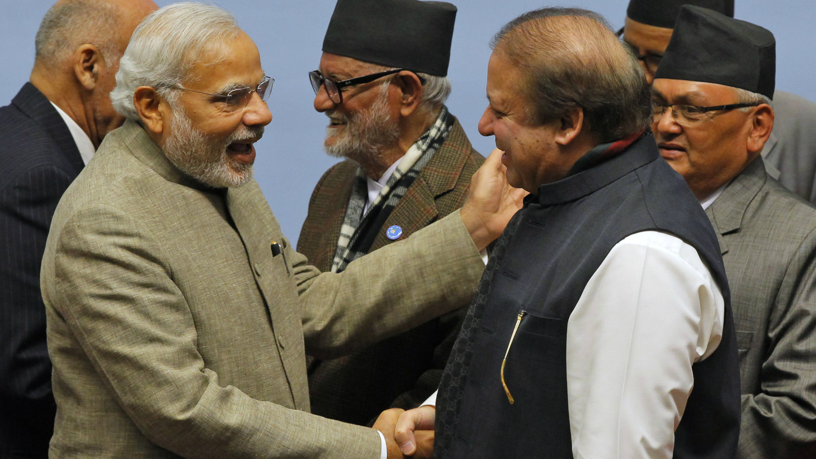 Pakistani Prime Minister Nawaz Sharif, right, and Indian Prime Minister Narendra Modi shake hands during the closing session of the 18th summit of the South Asian Association for Regional Cooperation (SAARC) in Katmandu, Nepal, Thursday, Nov. 27, 2014. South Asian heads of state attending their first summit in three years reached a deal on energy sharing Thursday, but failed on two other economic agreements during a retreat where Indian and Pakistan leaders shook hands. (