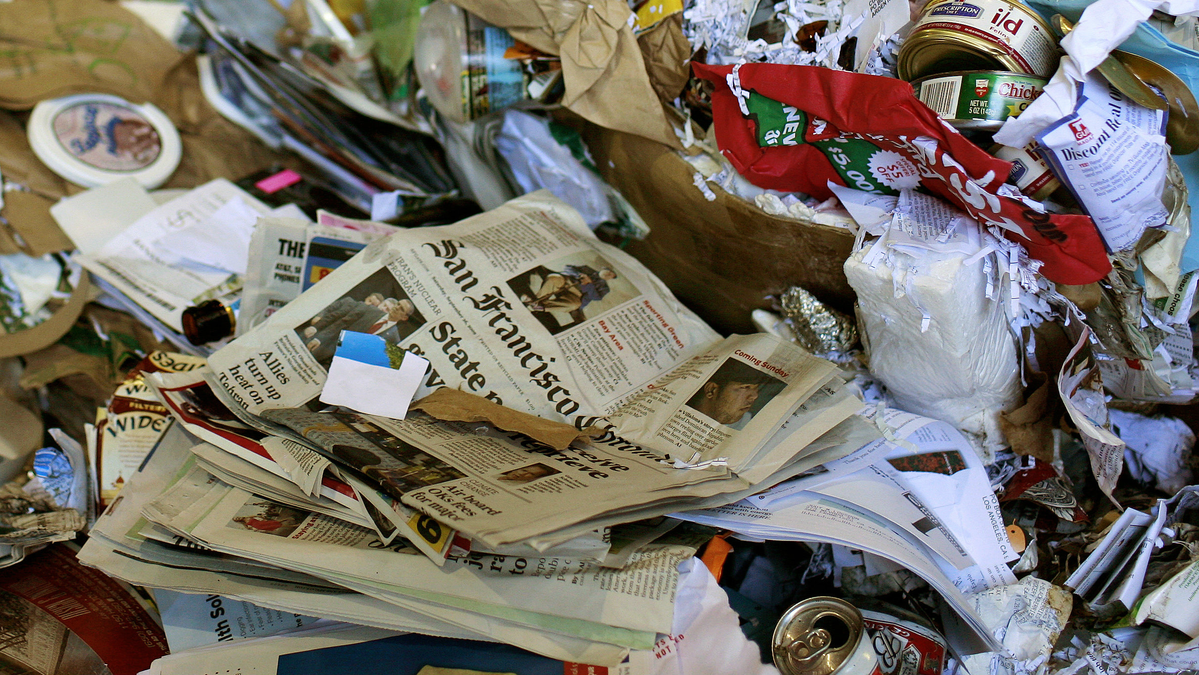 newspaper among trash