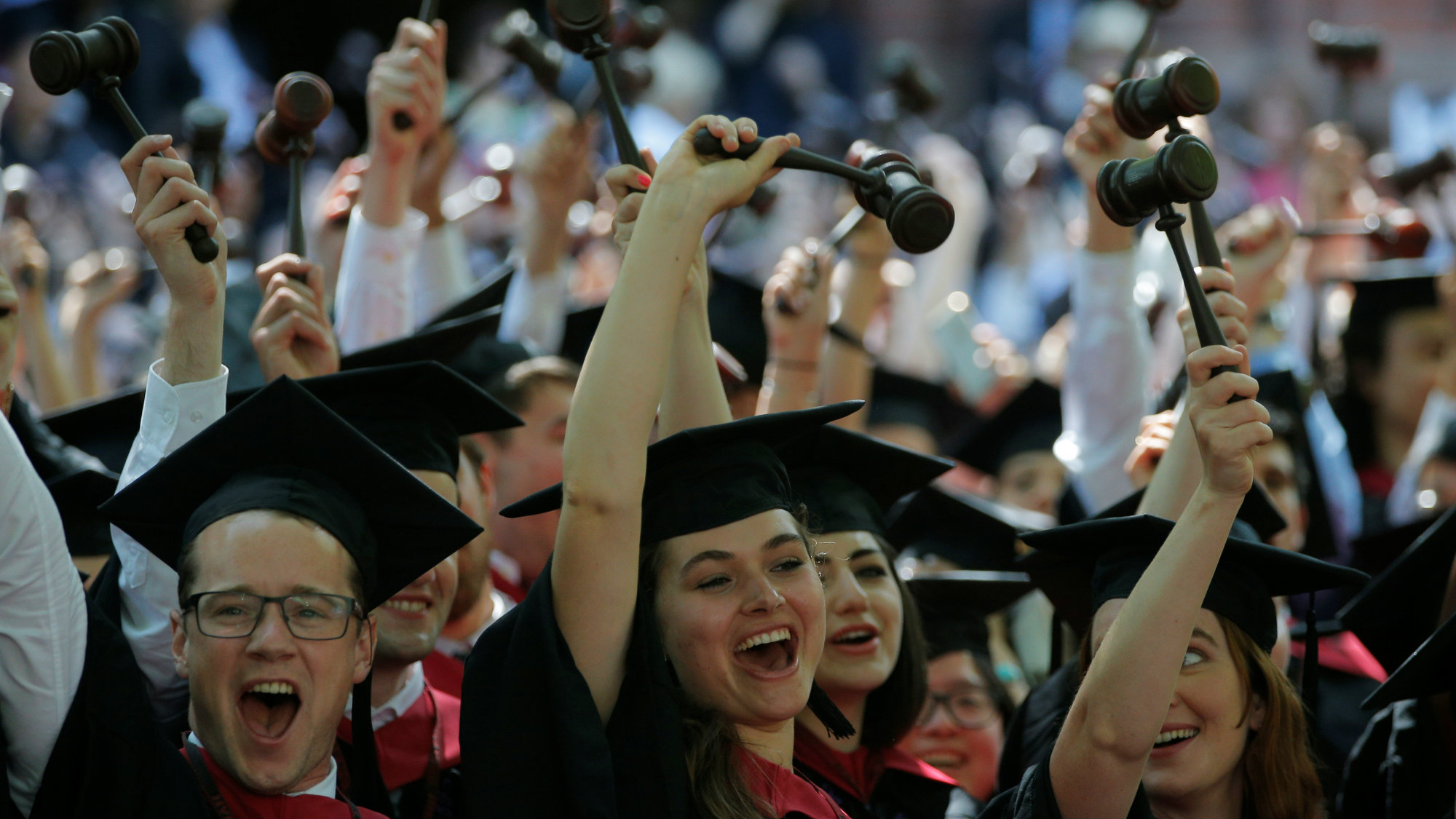 Graduating Law School students cheer as they receive their degrees during the 365th Commencement Exercises at Harvard University in Cambridge, Massachusetts, U.S. May 26, 2016.