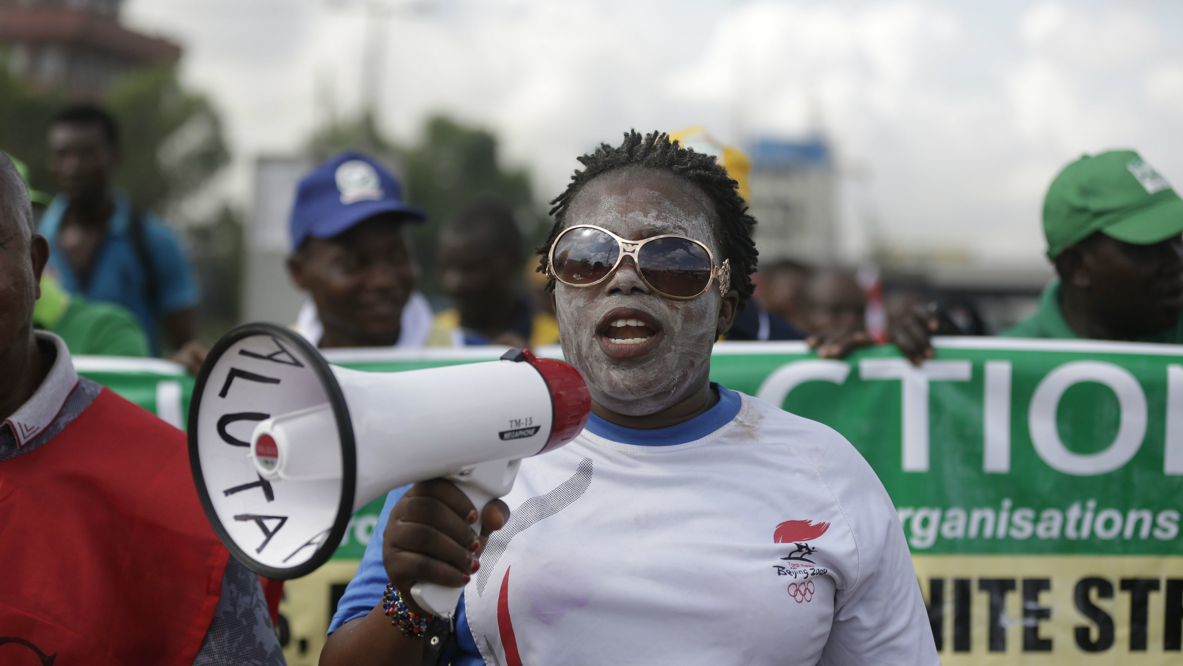 A woman joins in a protest following the removal of a fuel subsidy by the government in Lagos, Nigeria, Wednesday, May 18, 2016. Militant attacks on oil installations and the threat of a nationwide strike drove Nigeria's petroleum production and its naira currency to new lows Tuesday.