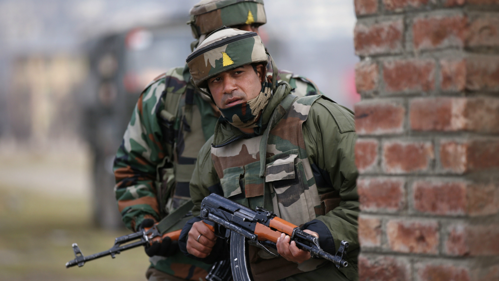 ndian army soldiers take their positions near the site of a gunbattle on the outskirts of Srinagar February 22, 2016.